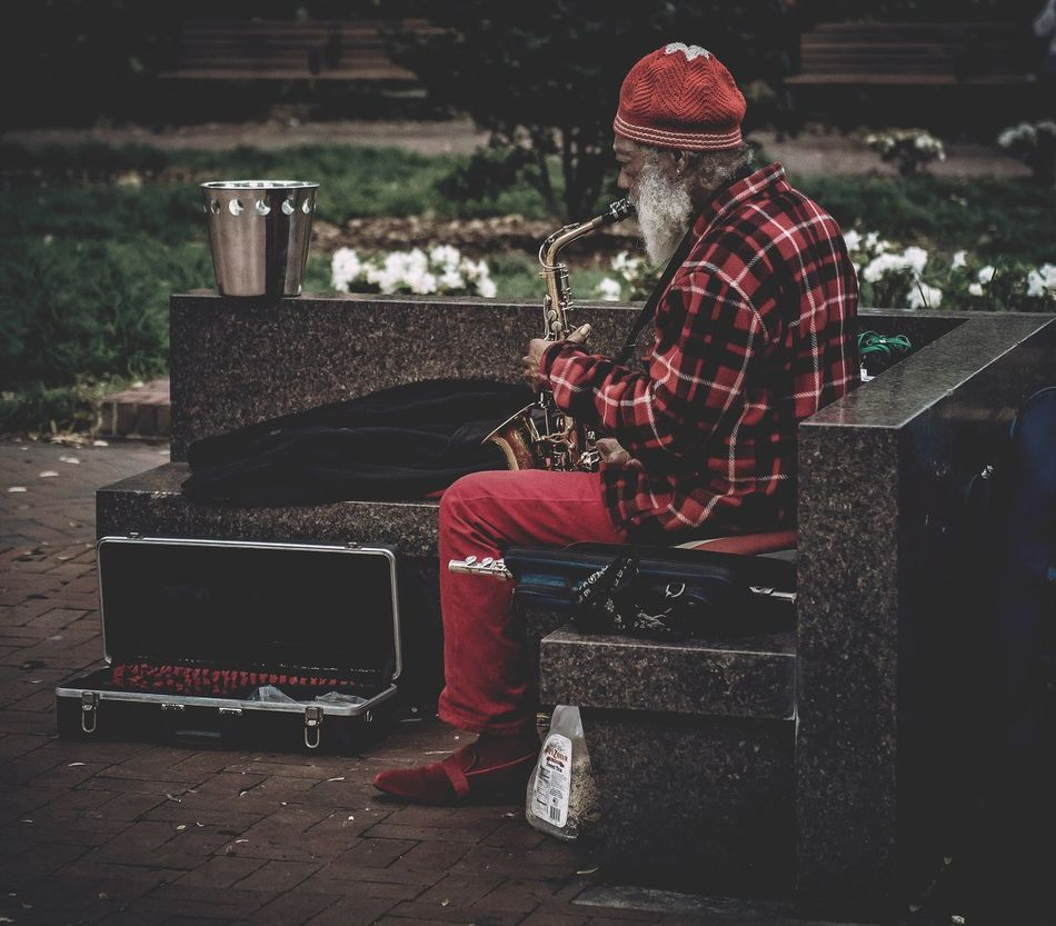 Sitting Streetphotography Street Photography Street Portrait City Life One Person Hat Music Full Length Outdoors People Winter Adult Musical Instrument Nature