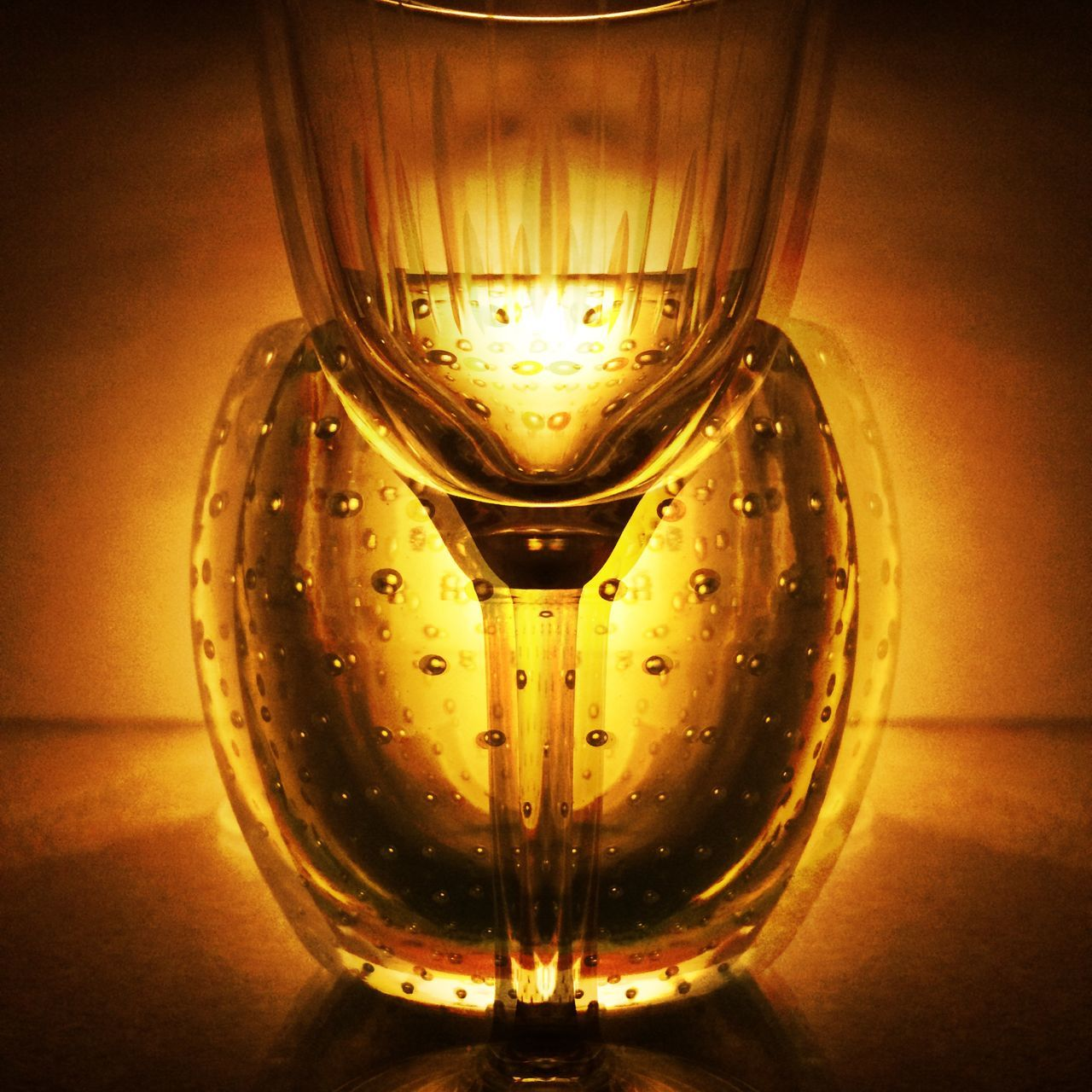 no people, glowing, indoors, table, close-up, drinking glass, illuminated, wine, drink, alcohol, filament
