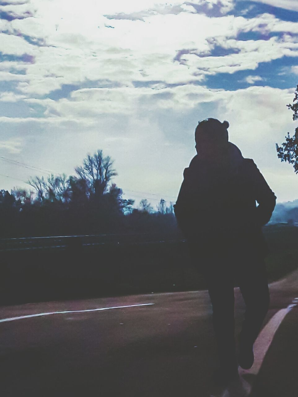 road, one person, sky, silhouette, full length, real people, cloud - sky, outdoors, men, rear view, transportation, day, lifestyles, tree, one man only, nature, adult, people
