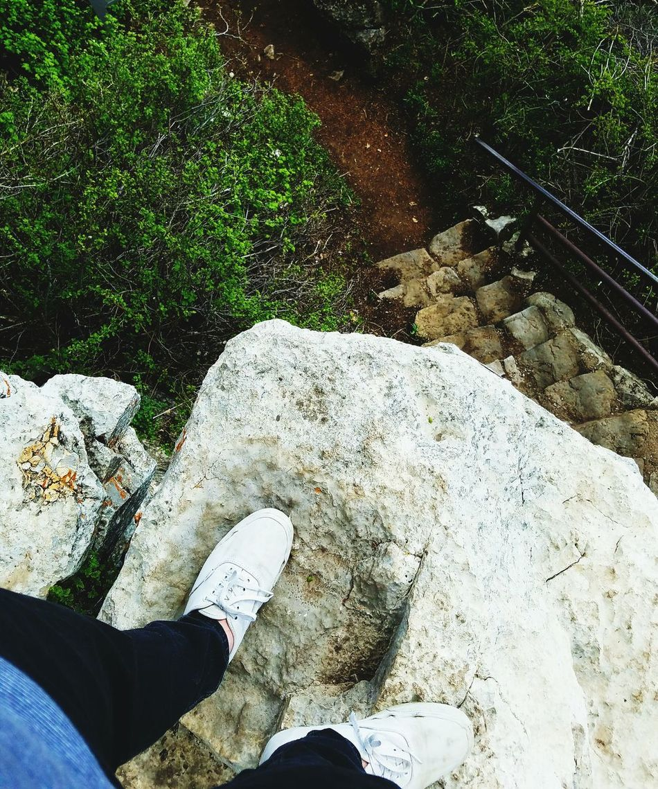 Mountain Hiking On A Cliff