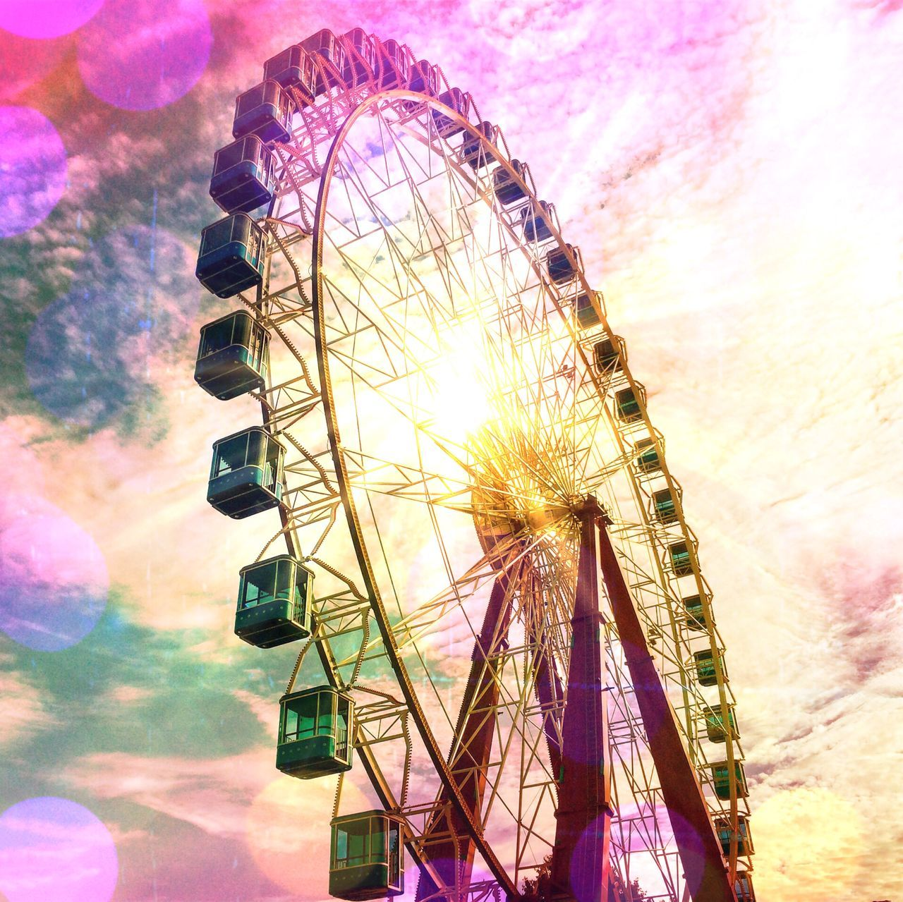 amusement park, arts culture and entertainment, ferris wheel, amusement park ride, fairground, low angle view, big wheel, no people, outdoors, sky, traveling carnival, day, multi colored, carousel