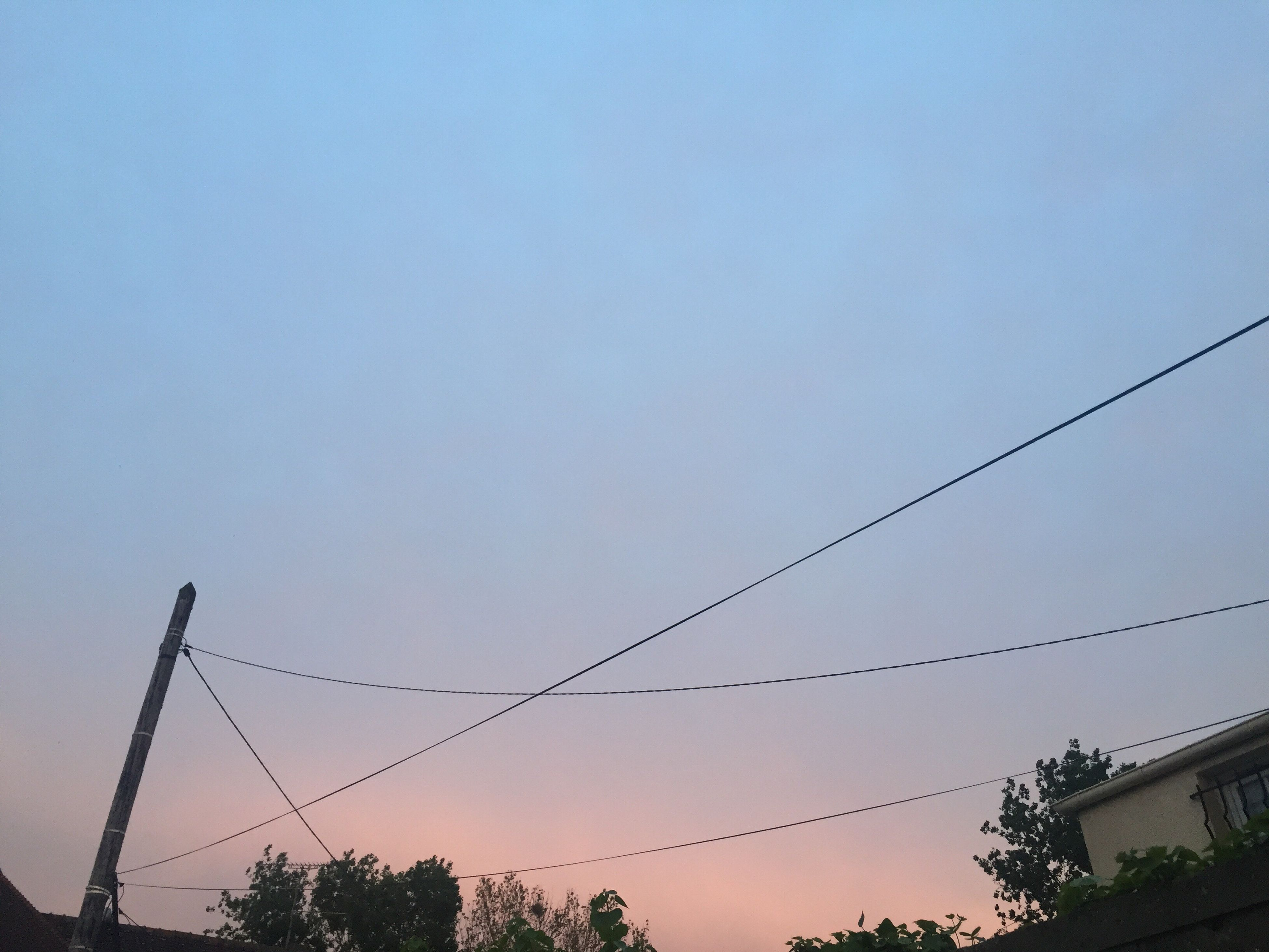 low angle view, power line, clear sky, silhouette, connection, electricity pylon, copy space, cable, power supply, electricity, sunset, tree, sky, dusk, power cable, nature, high section, technology, outdoors, fuel and power generation