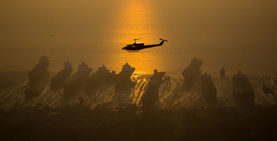 Airplane Architecture Bangladesh Beach Bell Helicopter Bell-212 Built Structure City EyeEmedityGetyimagenes Gold Colored Golden Hour Helicopter Landscape Nature Nautical Vessel No People Outdoors Sea Silhouette Sunset Travel Travel Destinations The City Light Flying High