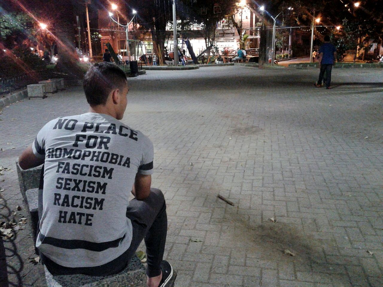 Guy wearing a no hatred tshirt while sitting in a park at night. Equality Equal Rights  No Hate Park - Man Made Space Person Man Tshirt Words Of Wisdom... Words Power Of Words  Back Of The Head Night Photography Street Photography At Night One Person Sitting Outside Sitting Alone Sitting Park Life Equal Love EqualityForAll Gay Rights Homophobia Sexism Racism