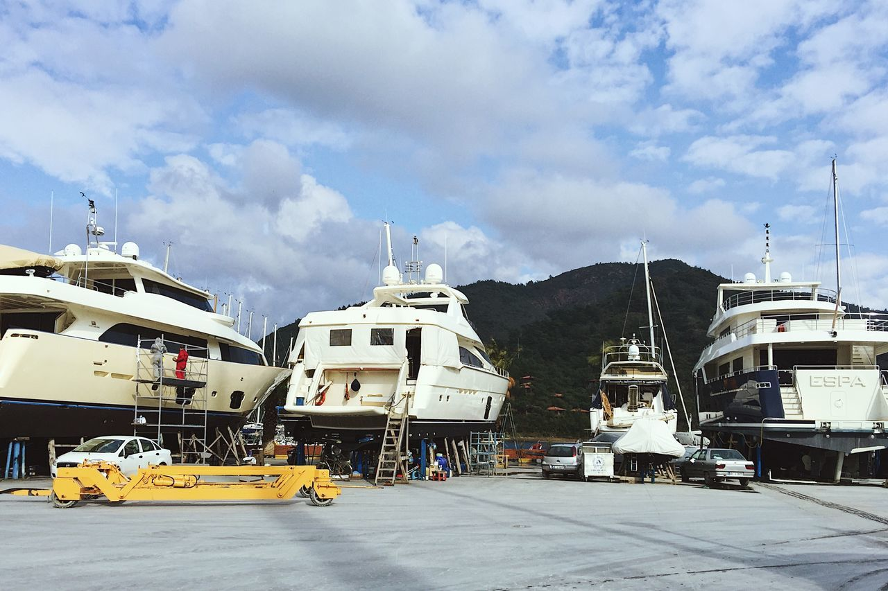 Super yachts are on lend taken care of during early spring season in Marmaris, Turkey Land Vehicle Marmaris Megayacht Mode Of Transport Nature Outdoors Port Repairs Sea Port Sky Superyacht Transportation Turkey Work In Progress Yacht Yachting
