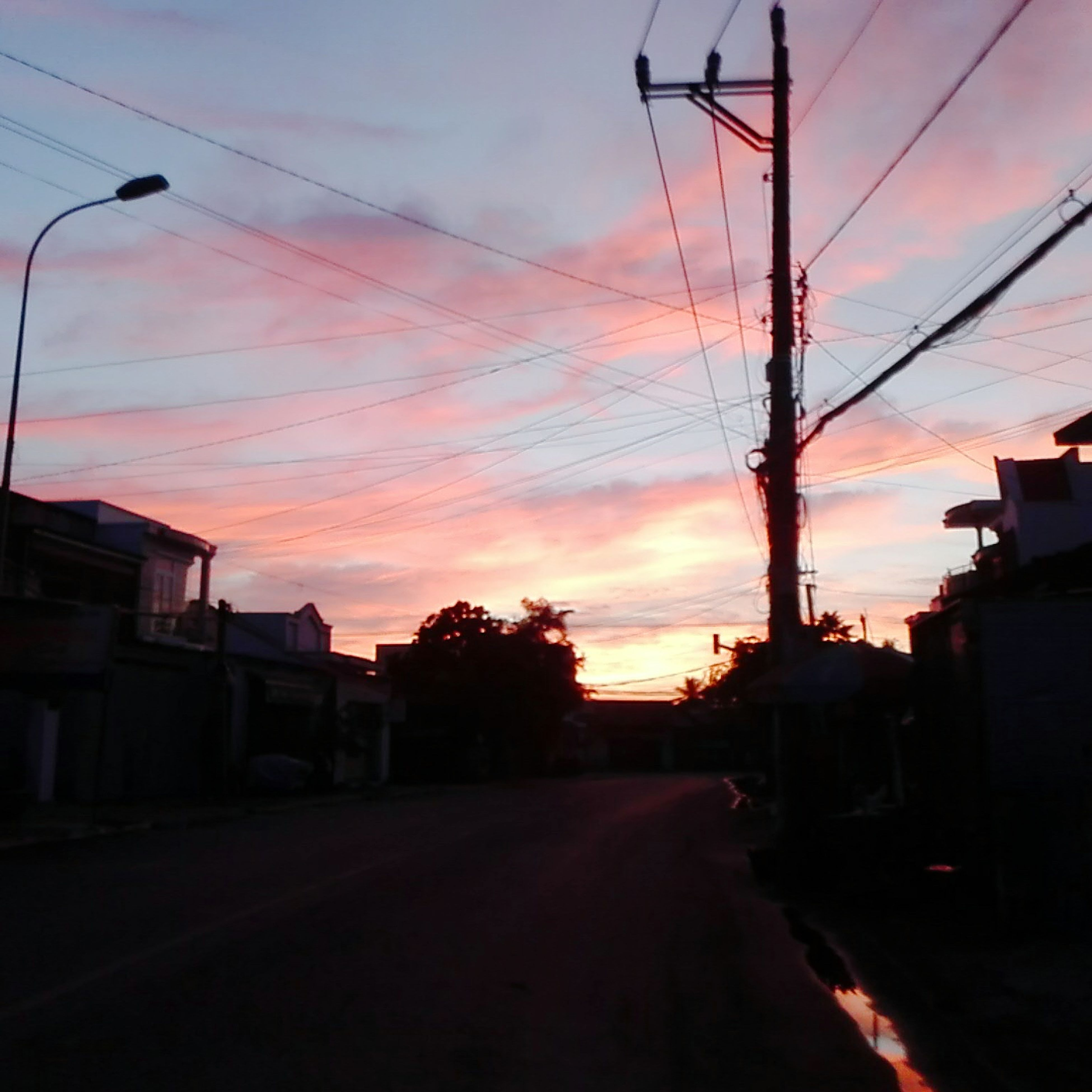sunset, sky, silhouette, cable, built structure, road, architecture, cloud - sky, power line, electricity pylon, no people, building exterior, outdoors, transportation, nature, telephone line, day