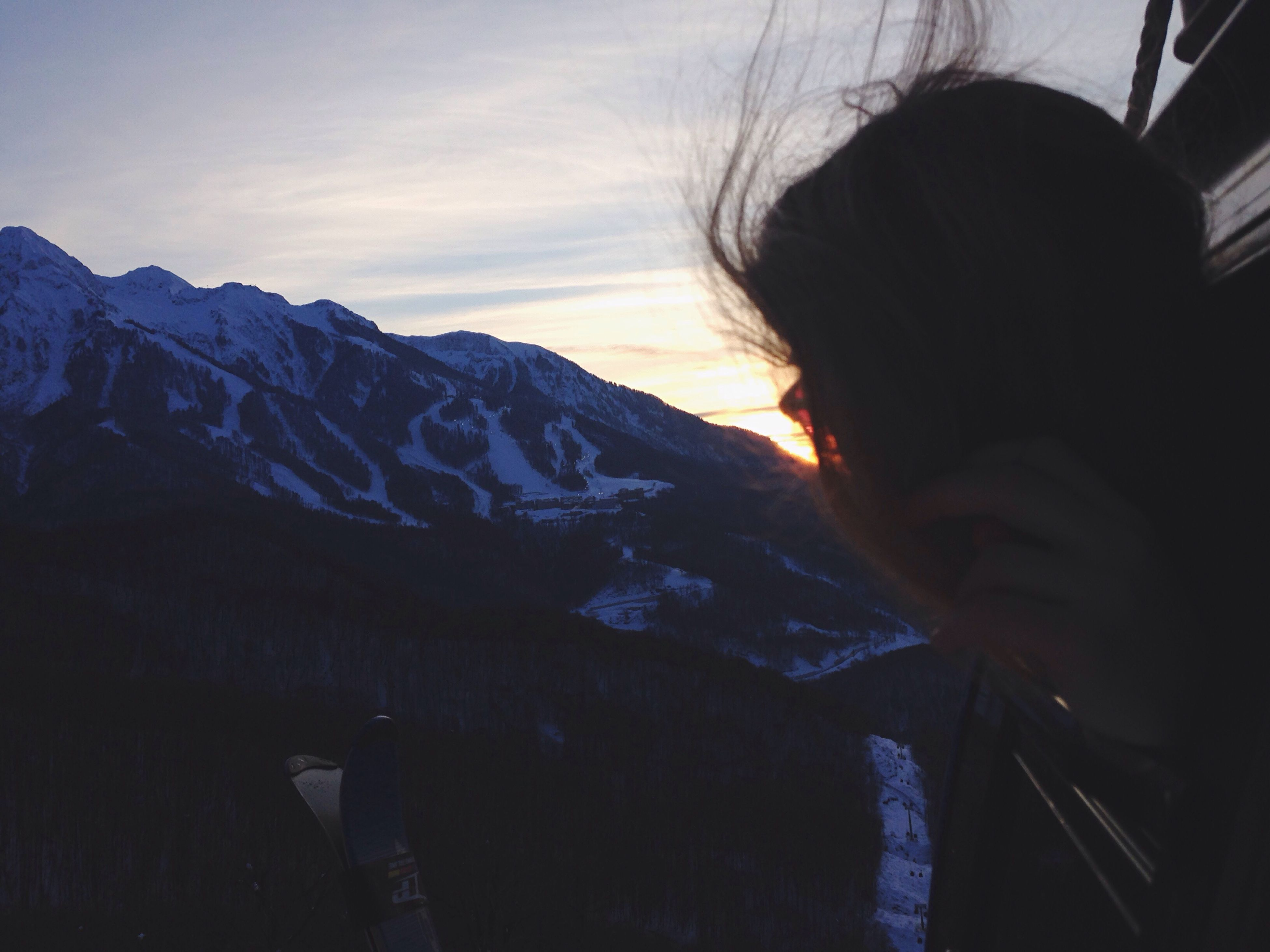 mountain, lifestyles, mountain range, sky, leisure activity, winter, tranquility, beauty in nature, tranquil scene, rear view, nature, scenics, cold temperature, long hair, person, weather, day, snow
