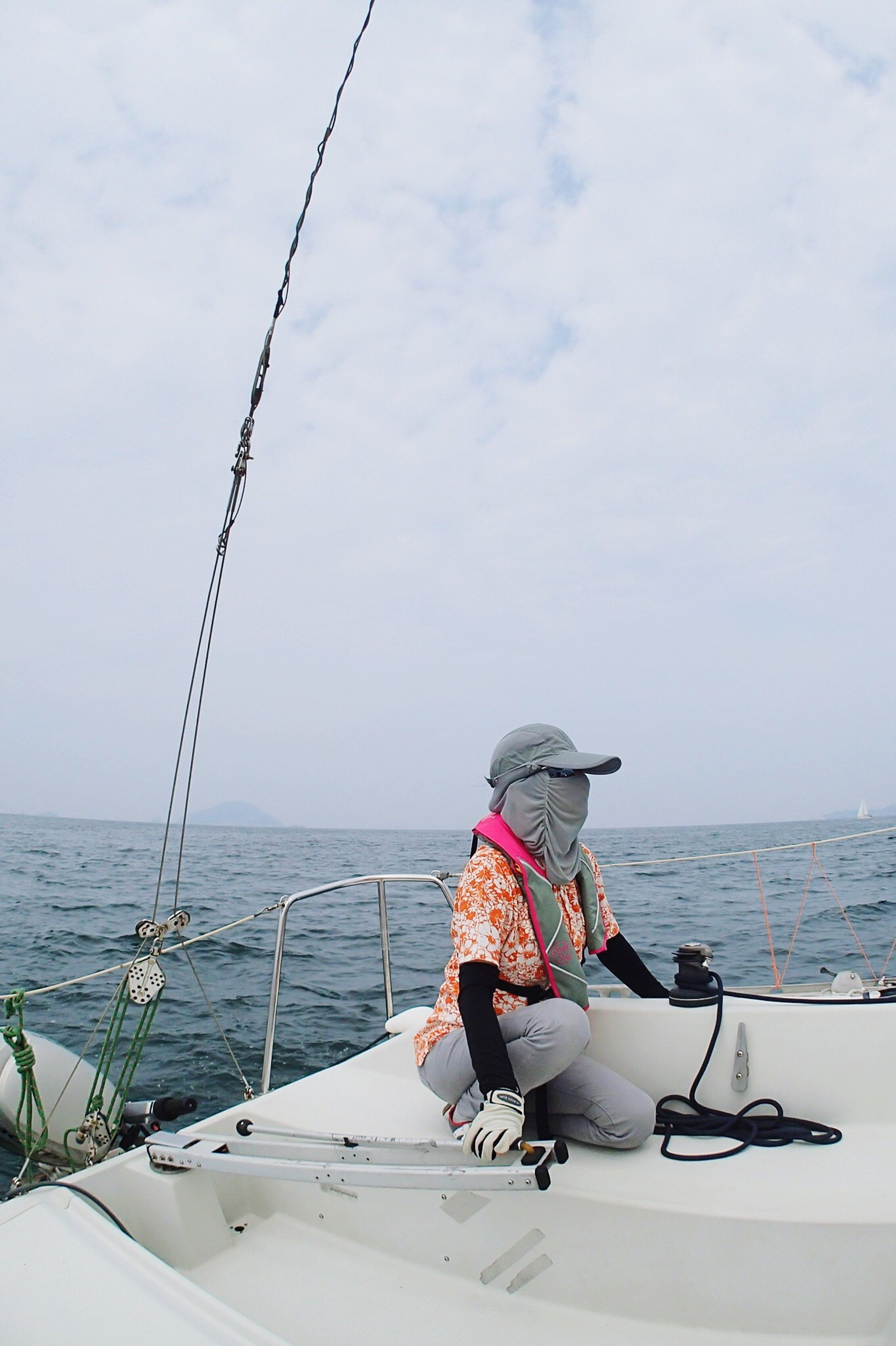 sea, water, transportation, horizon over water, nautical vessel, sitting, mode of transport, men, sky, casual clothing, day, remote, outdoors, solitude, scenics, tranquil scene, hobbies, nature, non-urban scene, vacations, tranquility