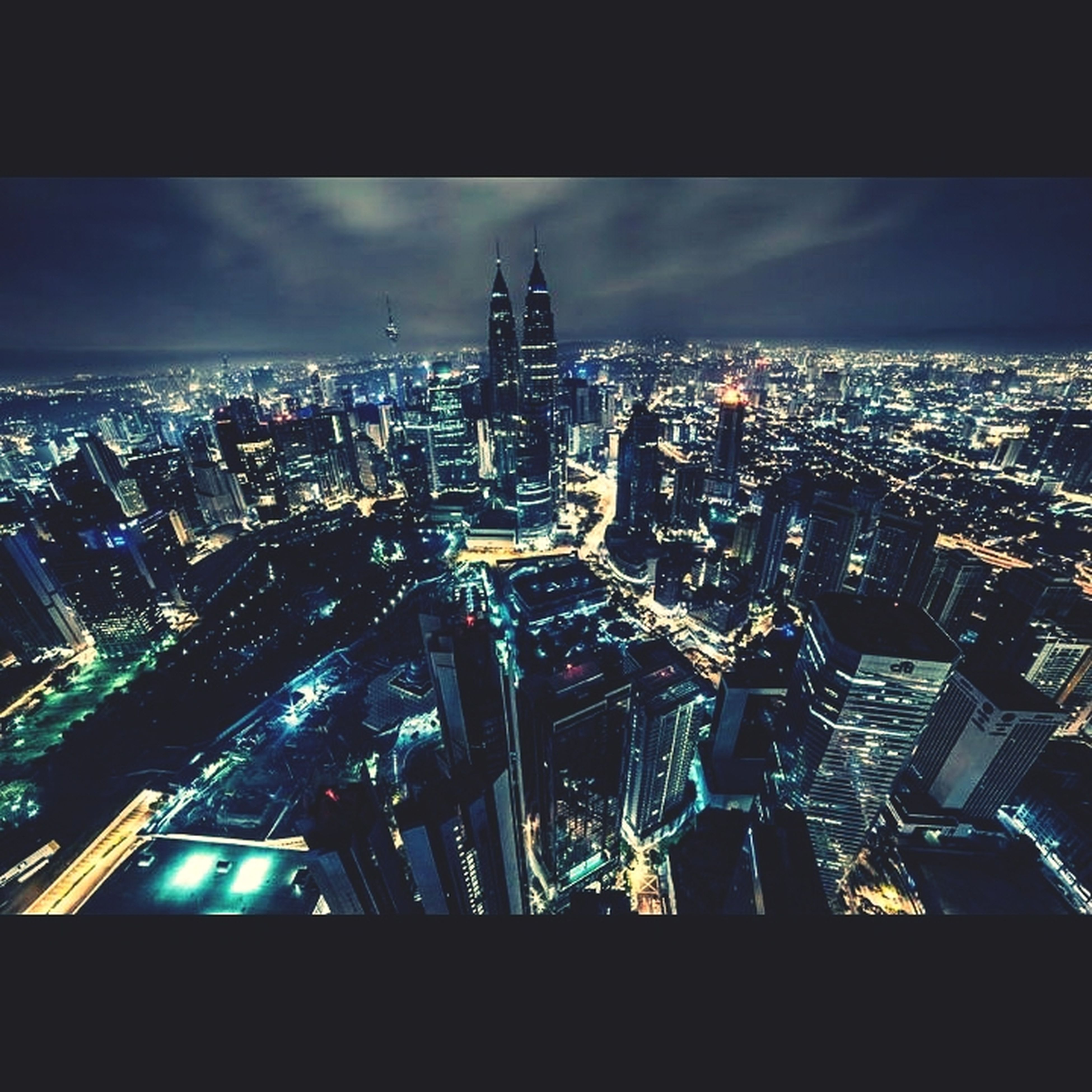 cityscape, city, architecture, building exterior, built structure, illuminated, skyscraper, crowded, night, sky, tall - high, tower, high angle view, modern, city life, residential district, capital cities, transfer print, office building, travel destinations