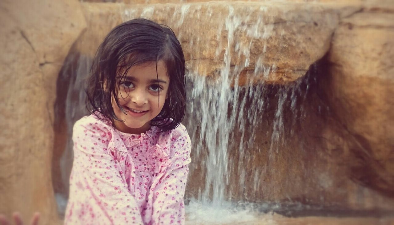 girls, childhood, child, children only, one girl only, smiling, portrait, standing, one person, looking at camera, happiness, day, outdoors, close-up, people