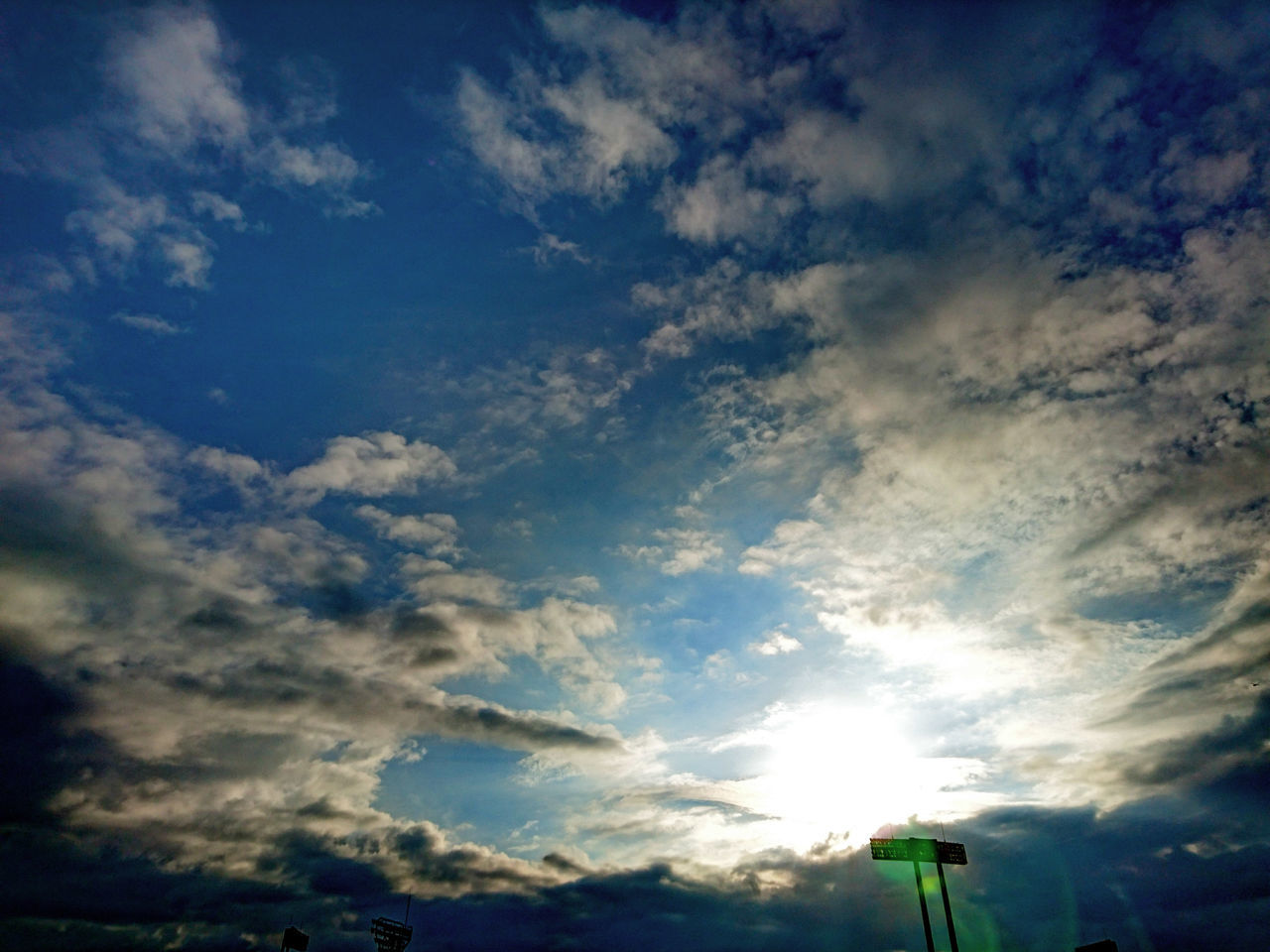 sky, cloud - sky, low angle view, beauty in nature, nature, scenics, no people, sun, outdoors, blue, sunset, day