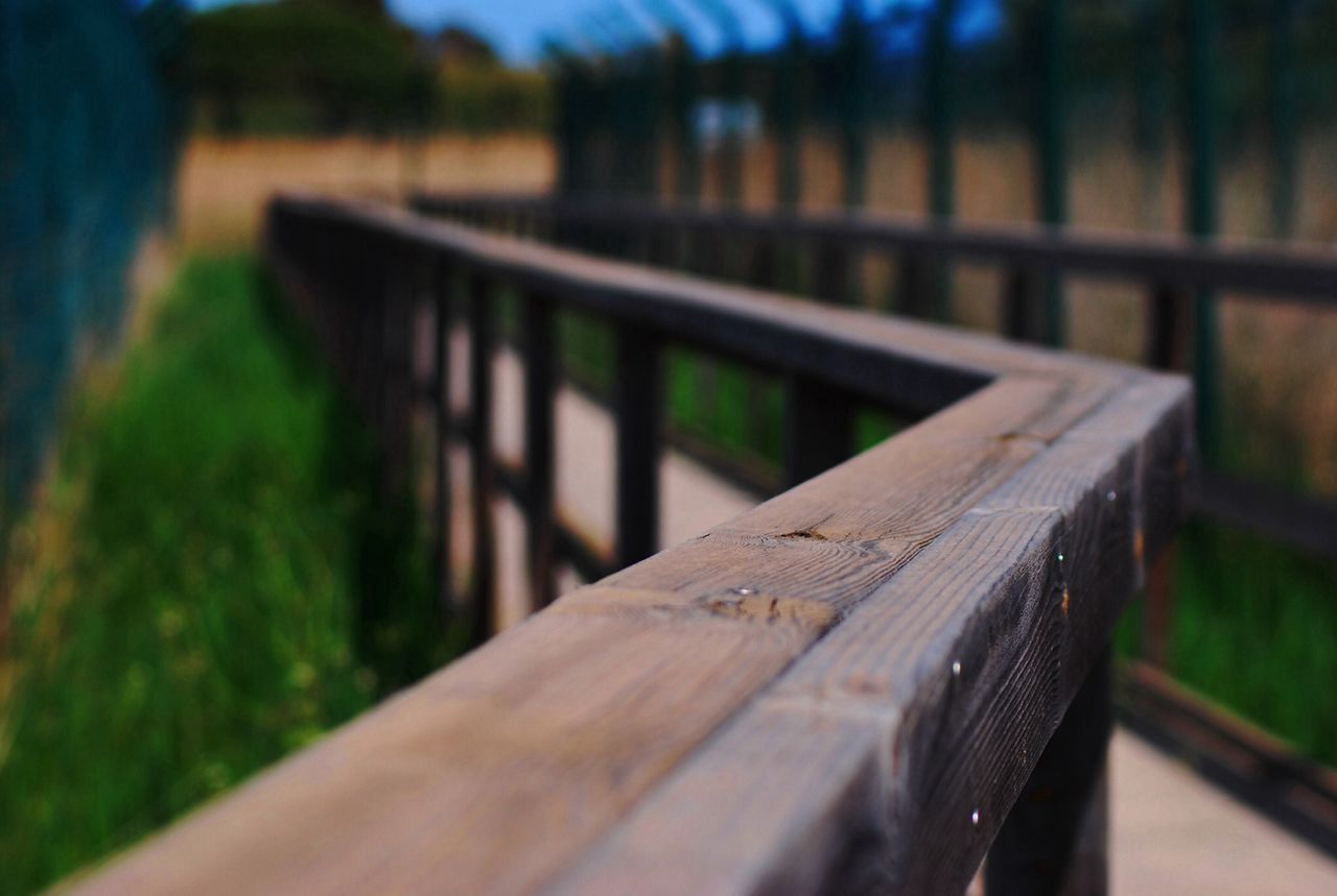 Close Up View Of Wooden Railing Of Bridge