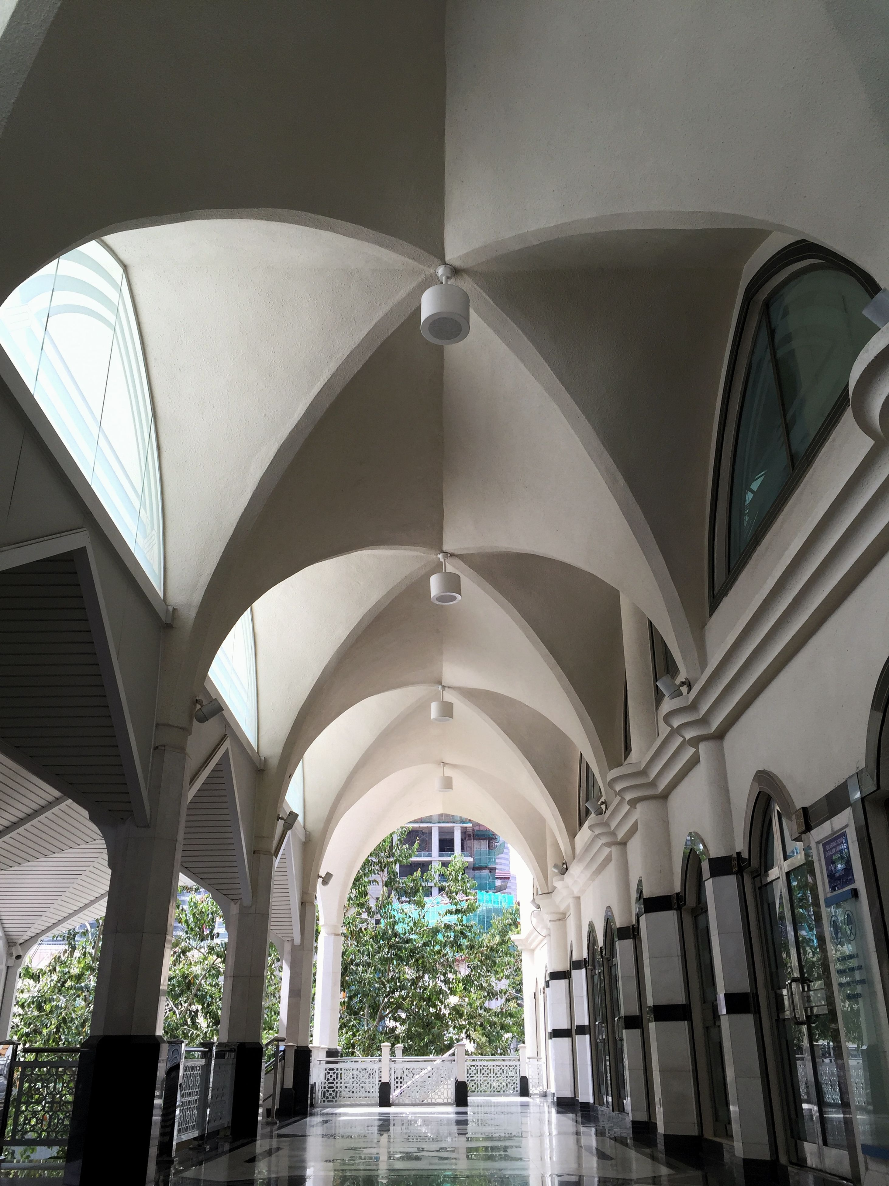 architecture, built structure, arch, building exterior, low angle view, indoors, architectural feature, ceiling, modern, architectural column, building, travel destinations, design, window, famous place, city, day, no people, dome, pattern