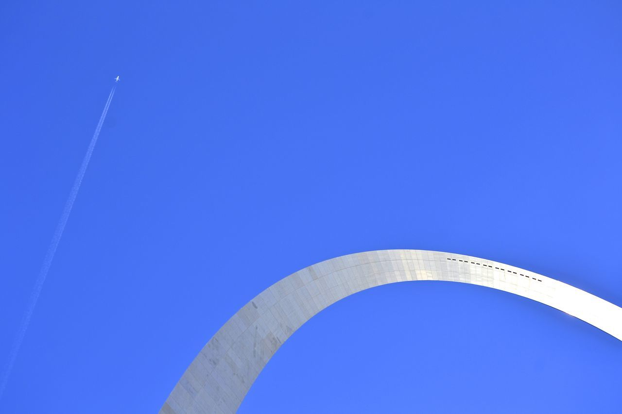 blue, low angle view, copy space, clear sky, outdoors, day, architecture, no people, built structure, sky, vapor trail