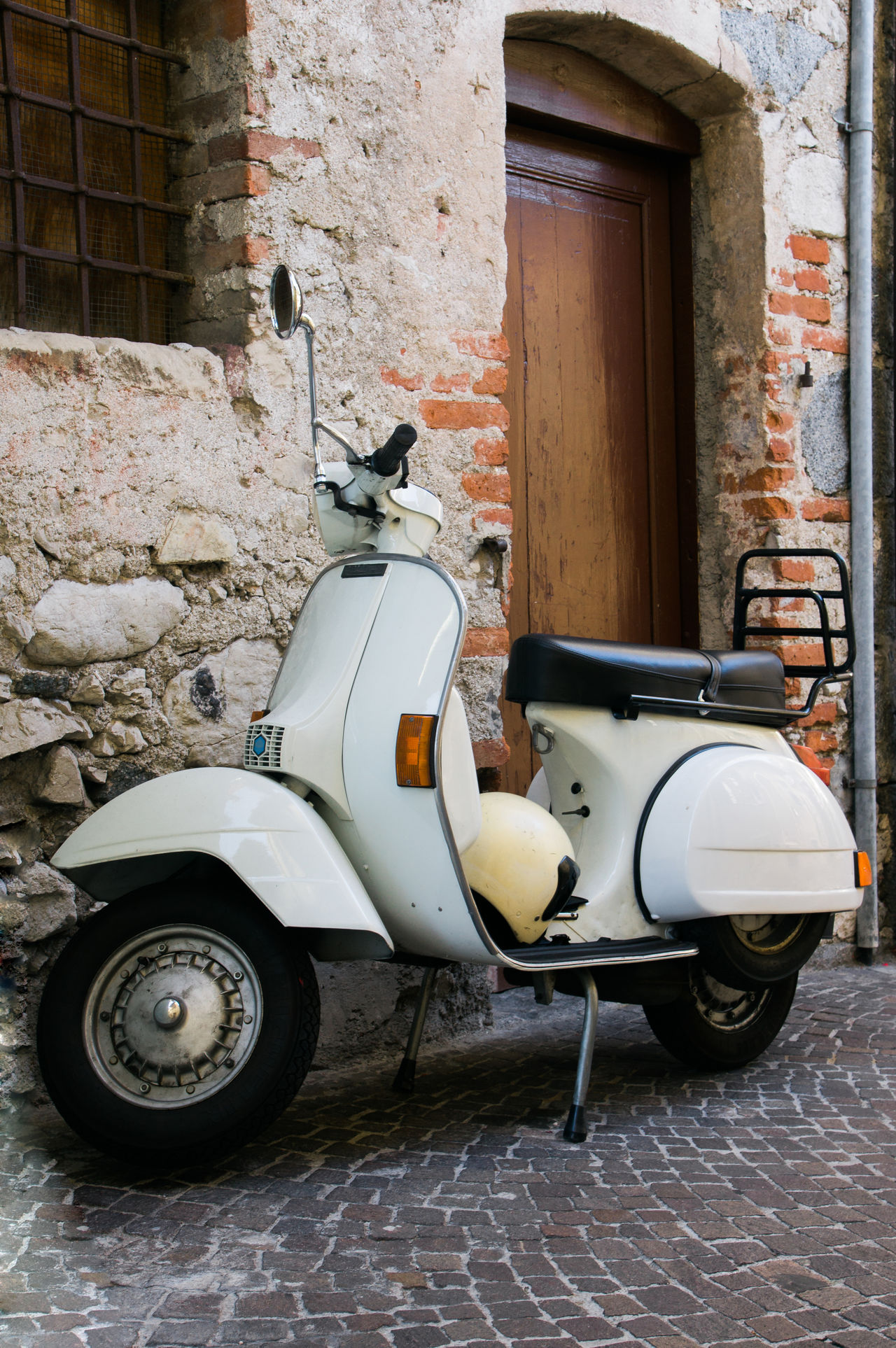 Architecture Brick Wall Building Exterior Built Structure Cobblestone Italian Style Land Vehicle Mode Of Transport Motor Scooter Motorbike No People Old-fashioned Outdoors Parking Retro Retro Style Scooter Stationary Streetphotography Transportation Typical Urban Vespa Vintage Vintage Style