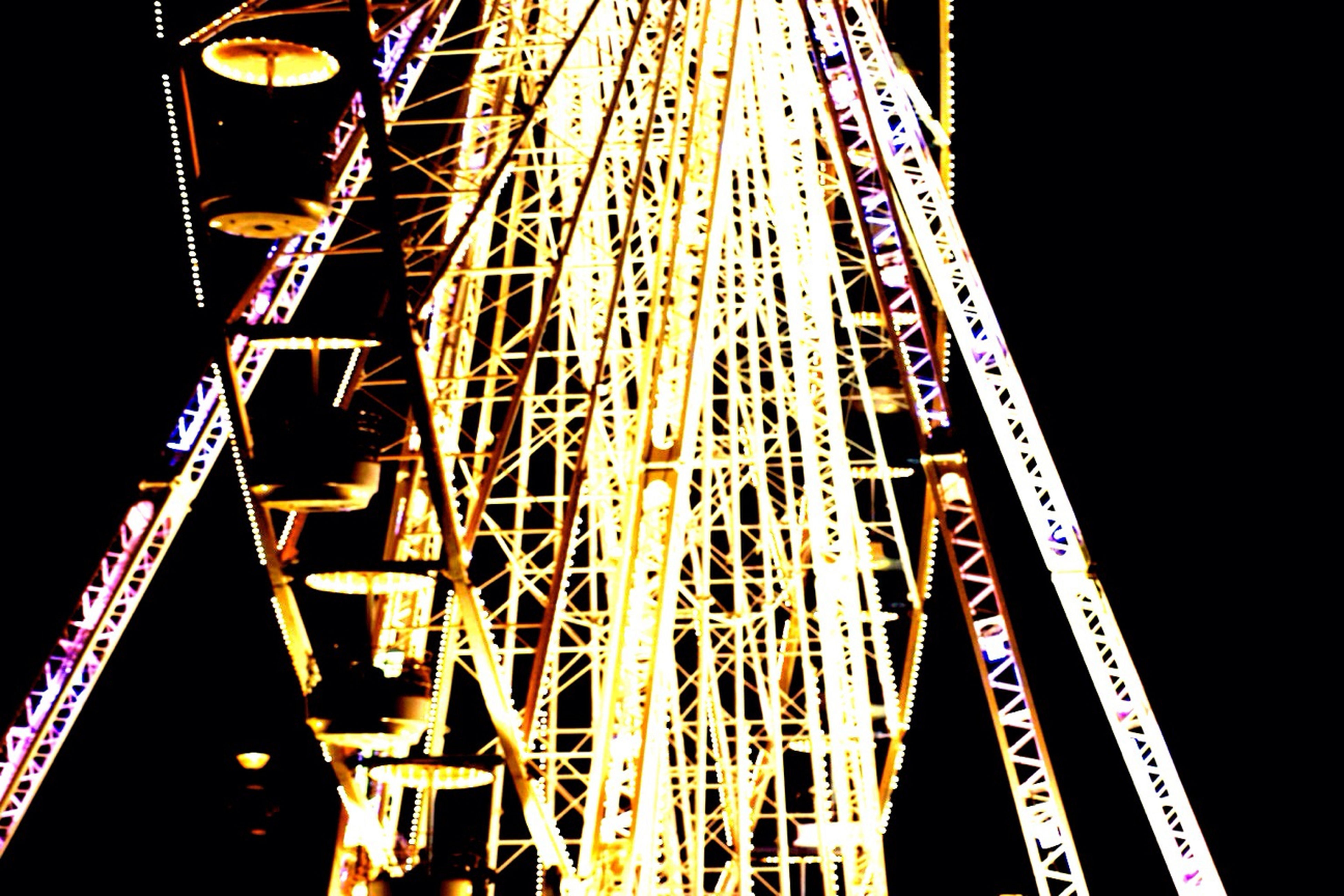 night, illuminated, metal, low angle view, arts culture and entertainment, connection, amusement park ride, amusement park, engineering, built structure, red, bridge - man made structure, ferris wheel, architecture, multi colored, transportation, metallic, outdoors, no people, sky
