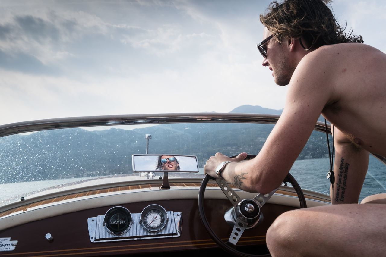 Beauty In Nature Day Leisure Activity Lifestyles Men Mode Of Transport Motorboat Nature Nautical Vessel One Person Outdoors People Real People Sea Sky Transportation Water Young Adult Young Men