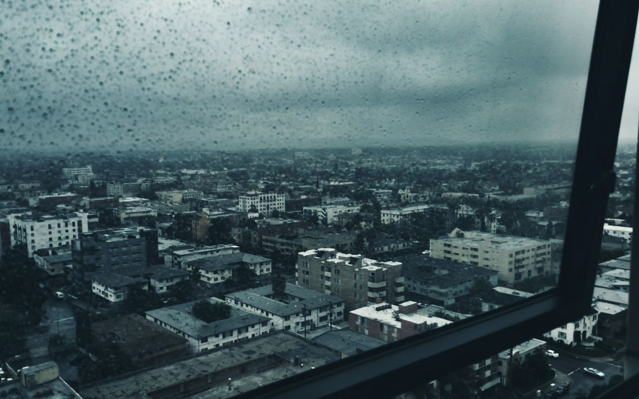What is this wet stuff falling from the sky? It Never Rains In LA Window Rain Rainy Days Cityscapes Clouds And Sky City View