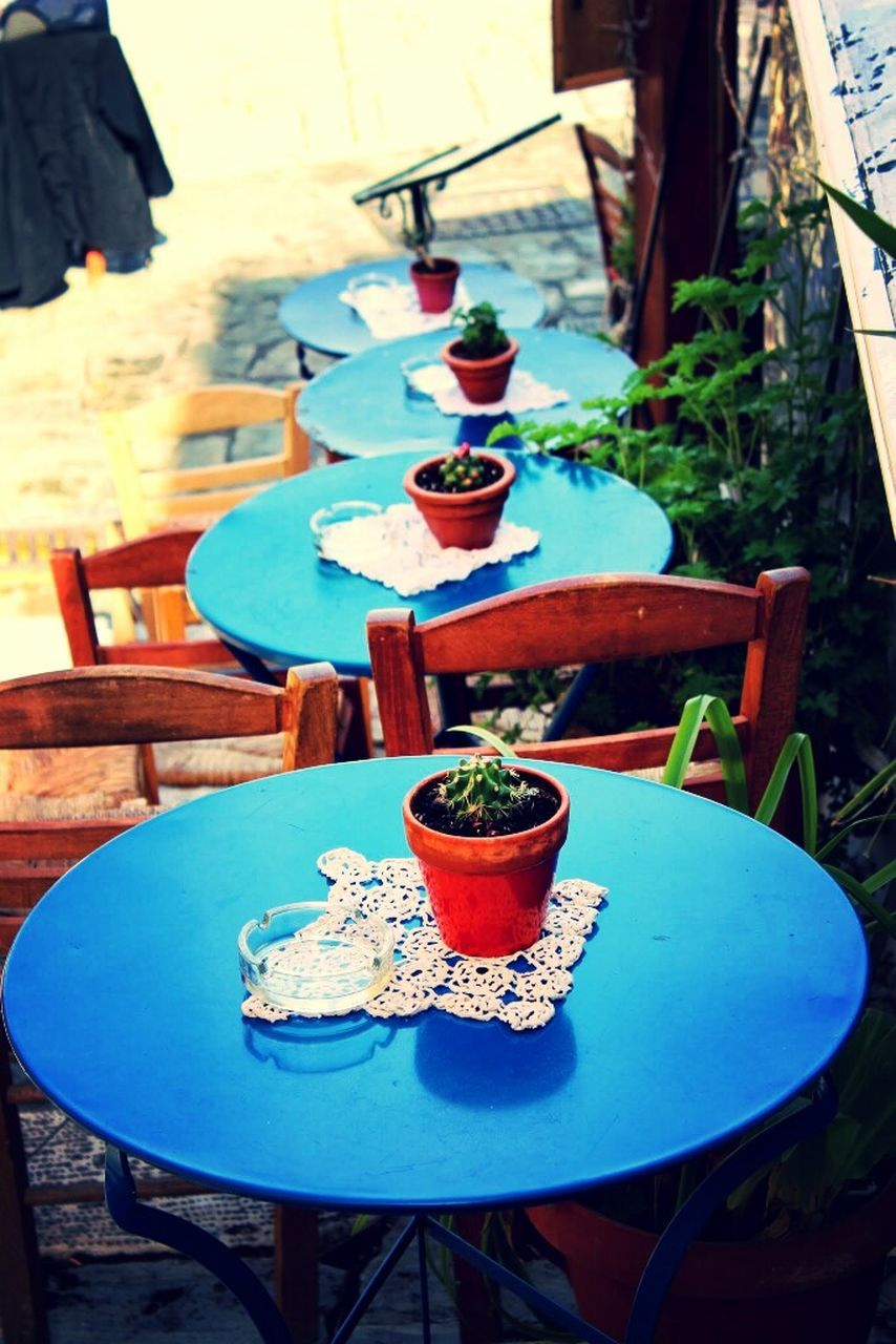 table, chair, plate, food and drink, absence, restaurant, outdoor cafe, sidewalk cafe, bowl, breakfast, outdoors, no people, place setting, refreshment, front or back yard, food, day, furniture, drinking glass, drink, healthy eating, cafe, freshness, tea - hot drink, close-up, nature, ready-to-eat