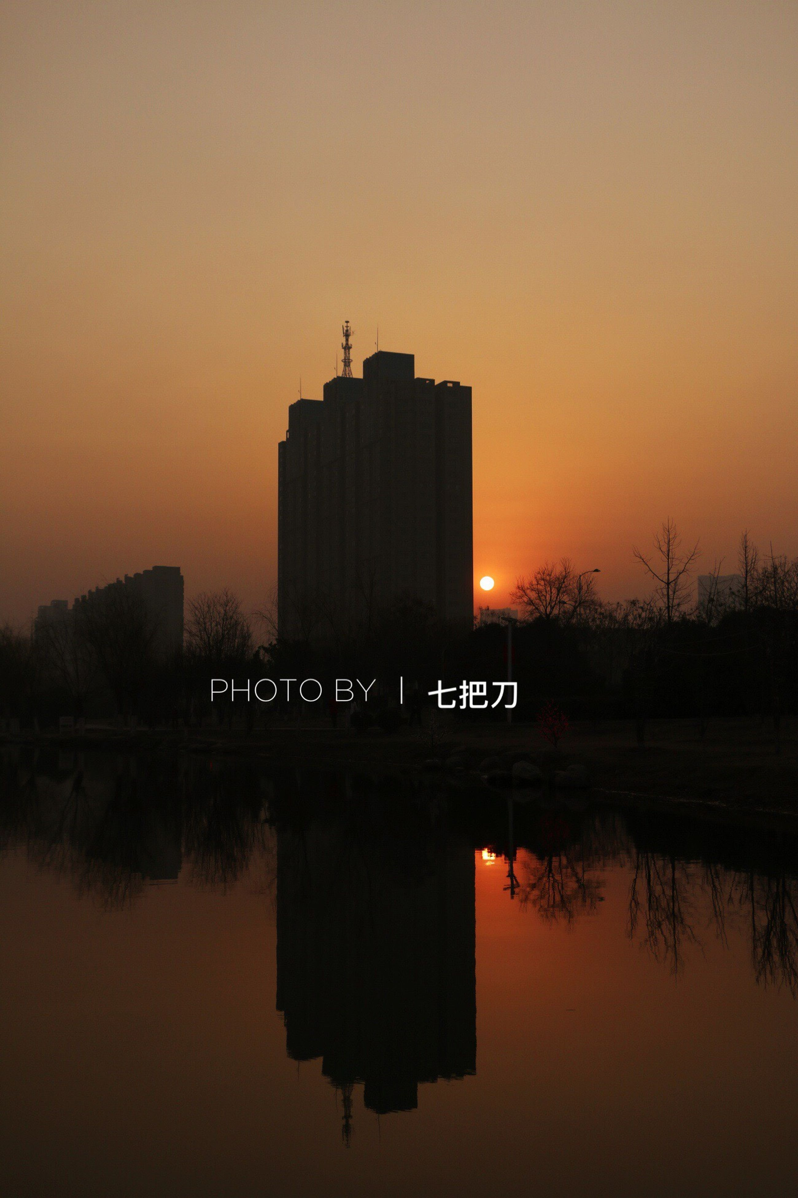 reflection, sunset, city, built structure, sky, water, architecture, fog, no people, outdoors, urban skyline, nature, day