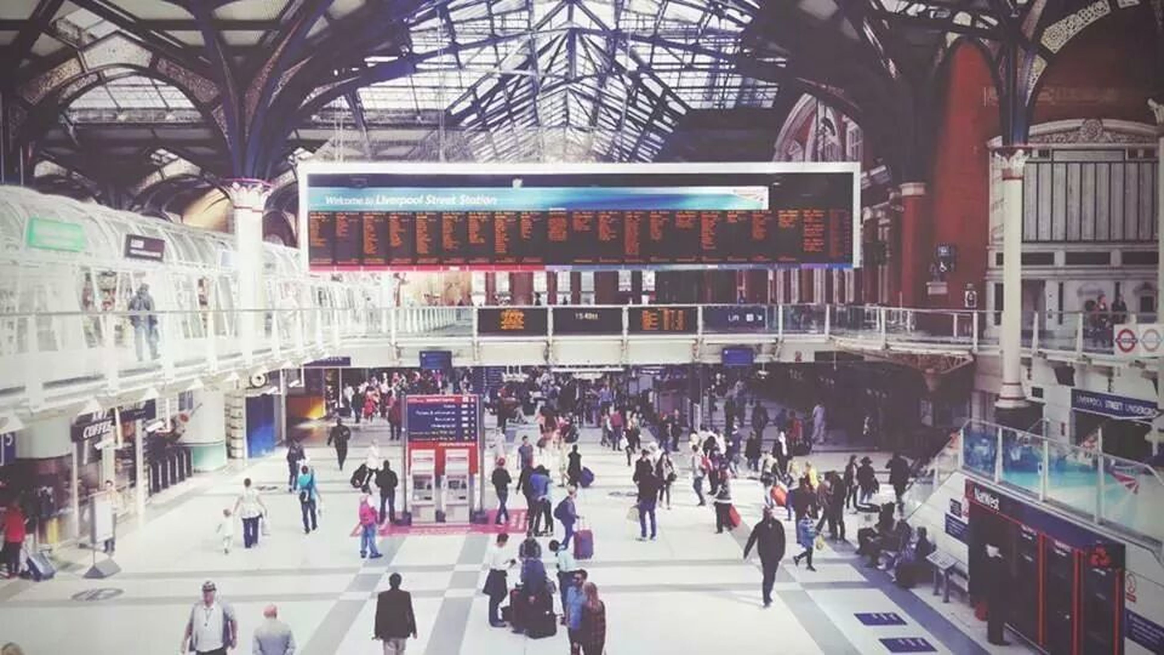 large group of people, indoors, architecture, built structure, person, public transportation, railroad station, men, transportation, travel, lifestyles, city life, rail transportation, travel destinations, ceiling, shopping mall, incidental people, walking, leisure activity