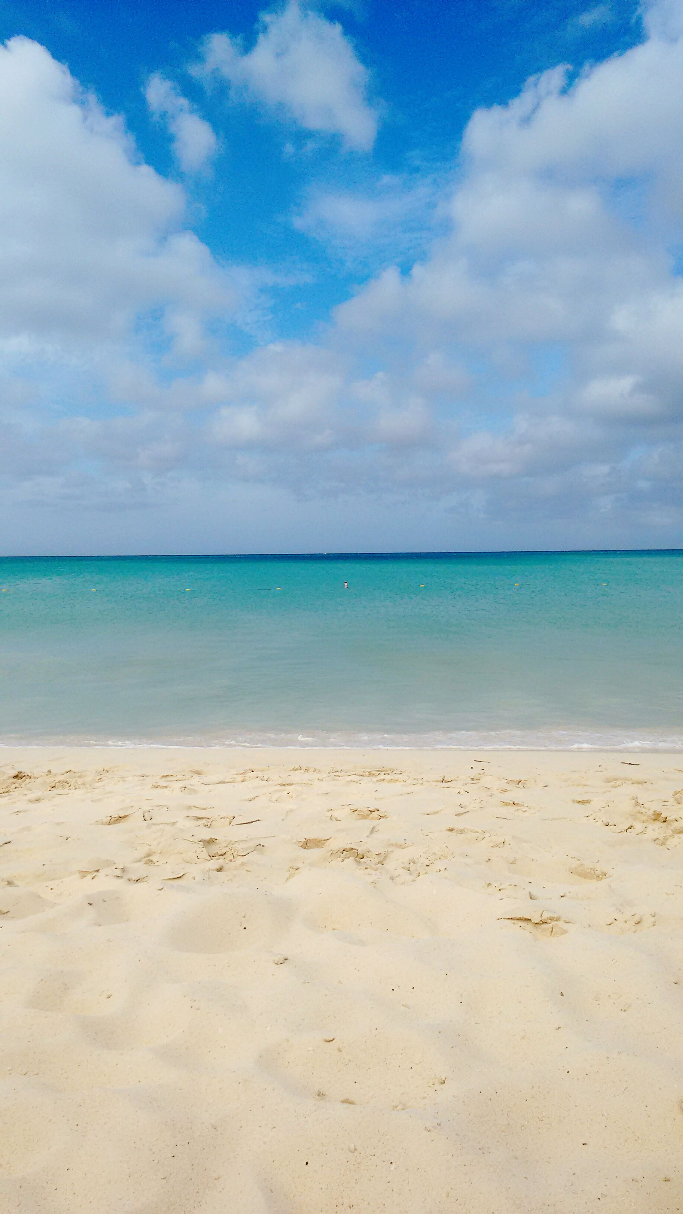 sea, beach, sky, horizon over water, nature, water, sand, scenics, beauty in nature, tranquility, tranquil scene, day, cloud - sky, outdoors, no people, blue, vacations