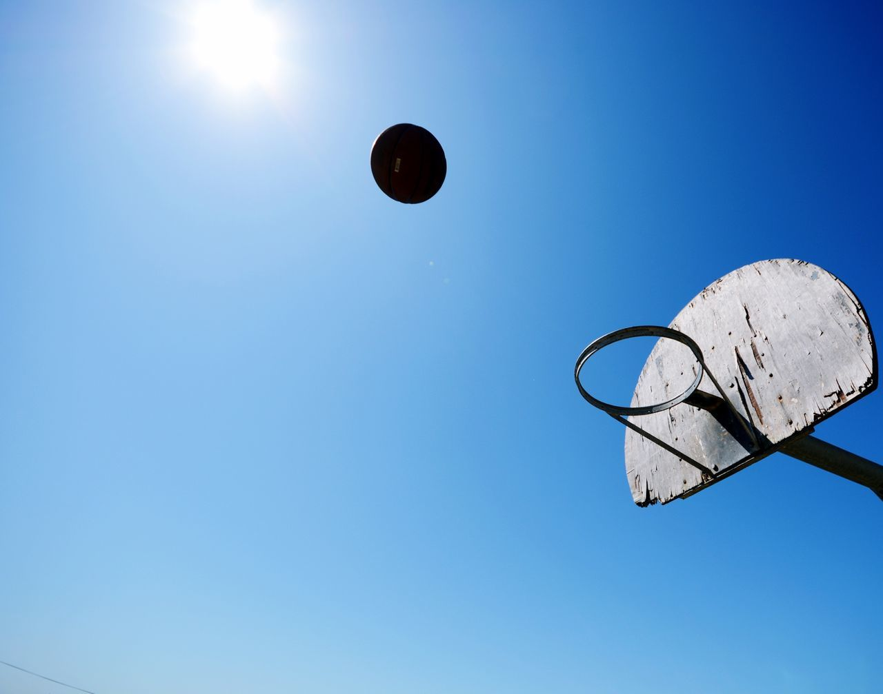 Above the rim Basketball Ball Hoop Sunrays Sky