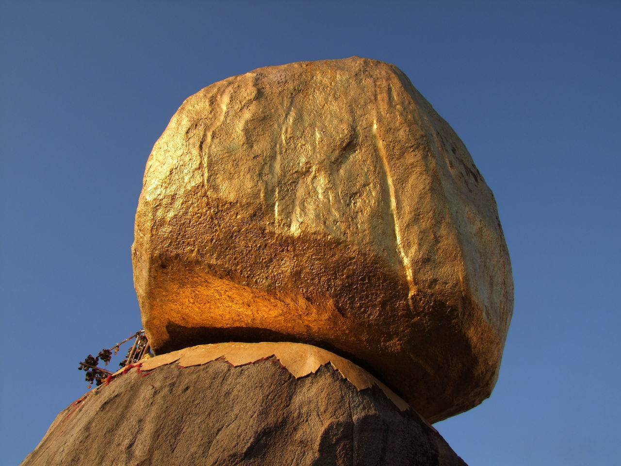 Golden Rock at Mount Kyaiktiyo Pagoda Blue Sky Boulder Boulder - Rock Buddhism Buddhist Pagoda Clear Sky Close Up Composition Full Frame Gold Coloured Golden Rock Golden Rock Pagoda Kinpun Low Angle View Mount Kyaiktiyo Mount Kyaiktiyo Pagoda Myanmar No People Outdoor Photography Place Of Pilgrimage Place Of Prayer Place Of Worship Rock Sunlight And Shade Travel Destination