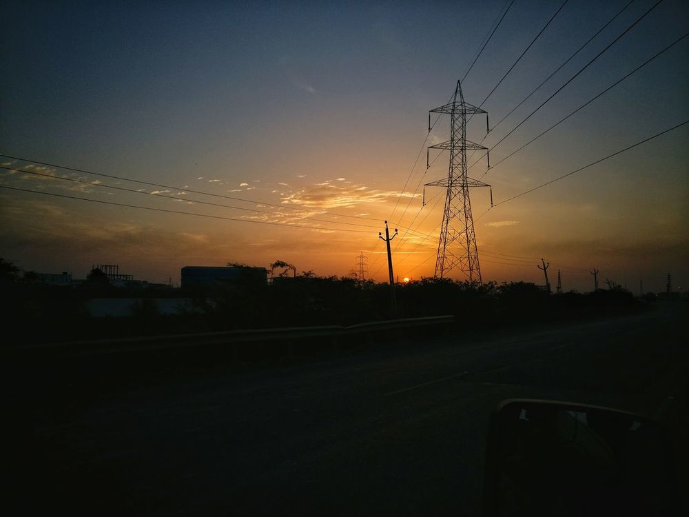 The Sun Sunset Silhouette No People Technology Flying Sky Nature Telephone Line Outdoors Electricity Pylon City Day Traveling Travel Photography Roadtrip Sky And Clouds Skyporn Orange Color Orange Sky Tower Electricity  Landscape_Collection Nature First Eyeem Photo