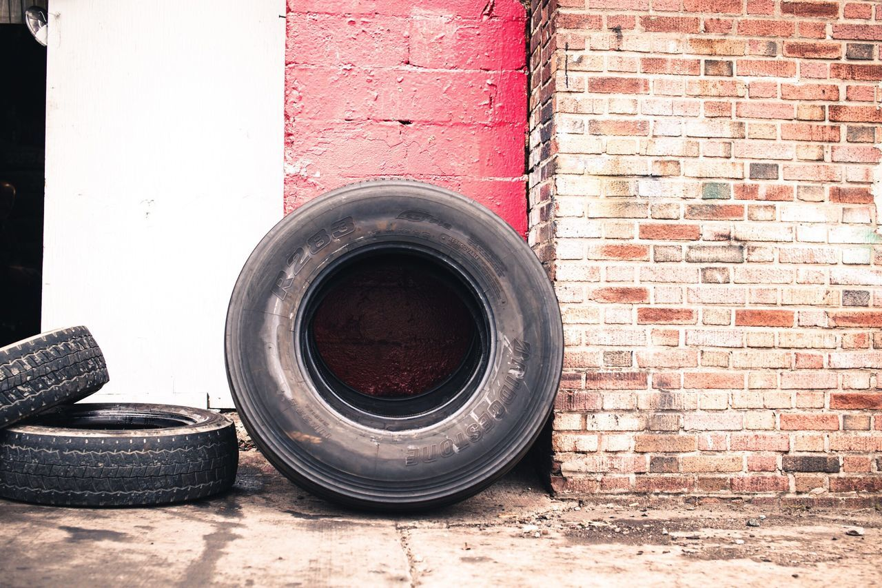 no people, brick wall, day, architecture, tire, indoors, close-up