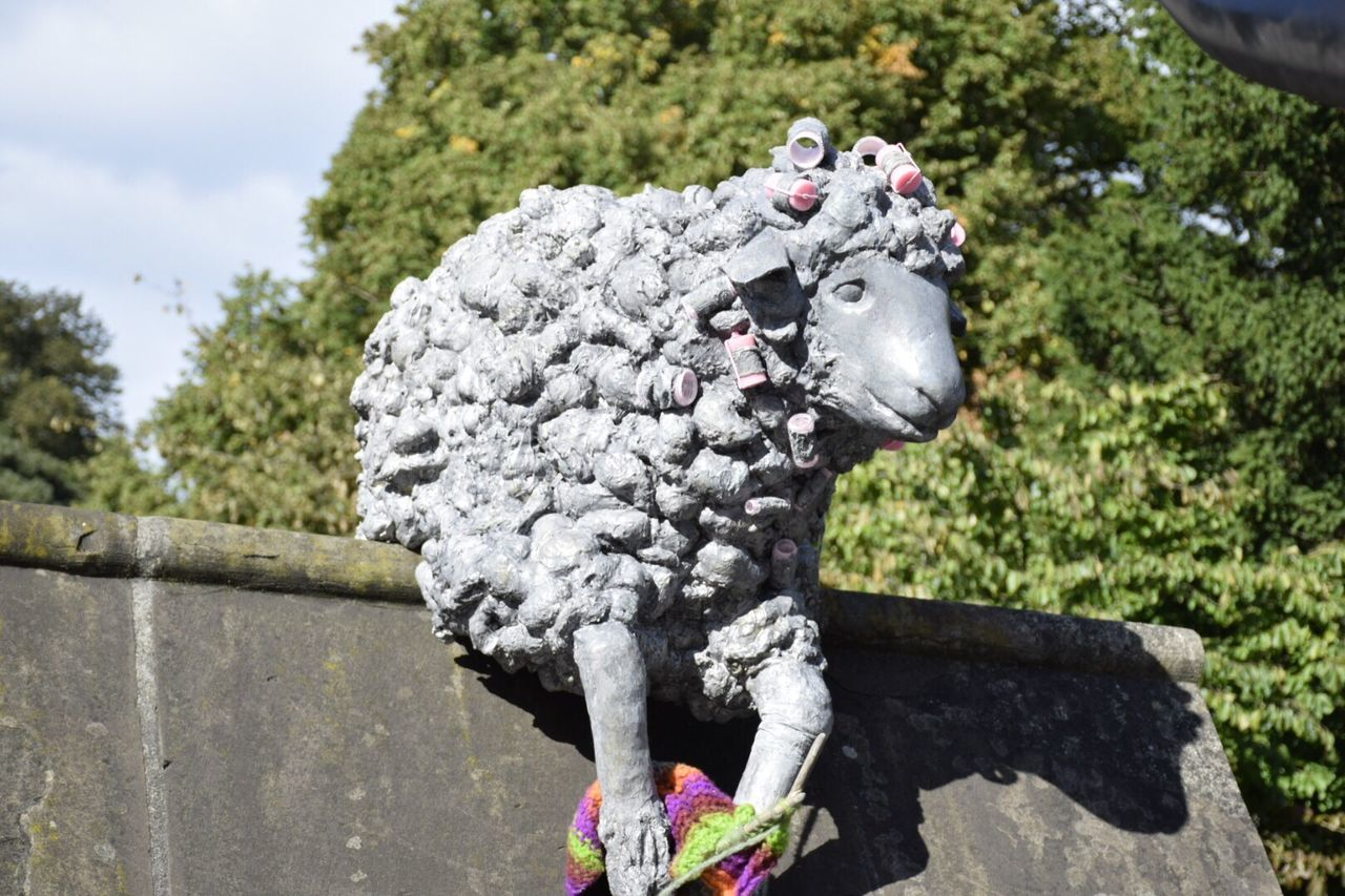 Focus On Foreground Day Sky Creativity No People Sculpture Selective Focus Resting Art And Craft Statue Creativity Animal Themes City Of The Unexpected Sheep Statue