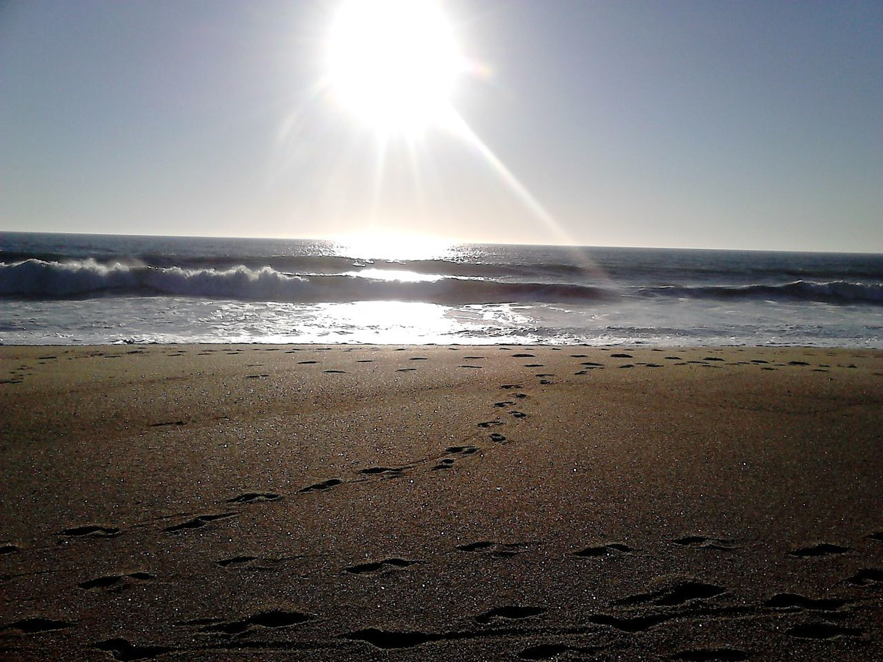 sun, sea, beauty in nature, nature, sunbeam, beach, sunlight, scenics, lens flare, tranquility, sand, water, sky, tranquil scene, horizon over water, no people, outdoors, sunset, day, wave