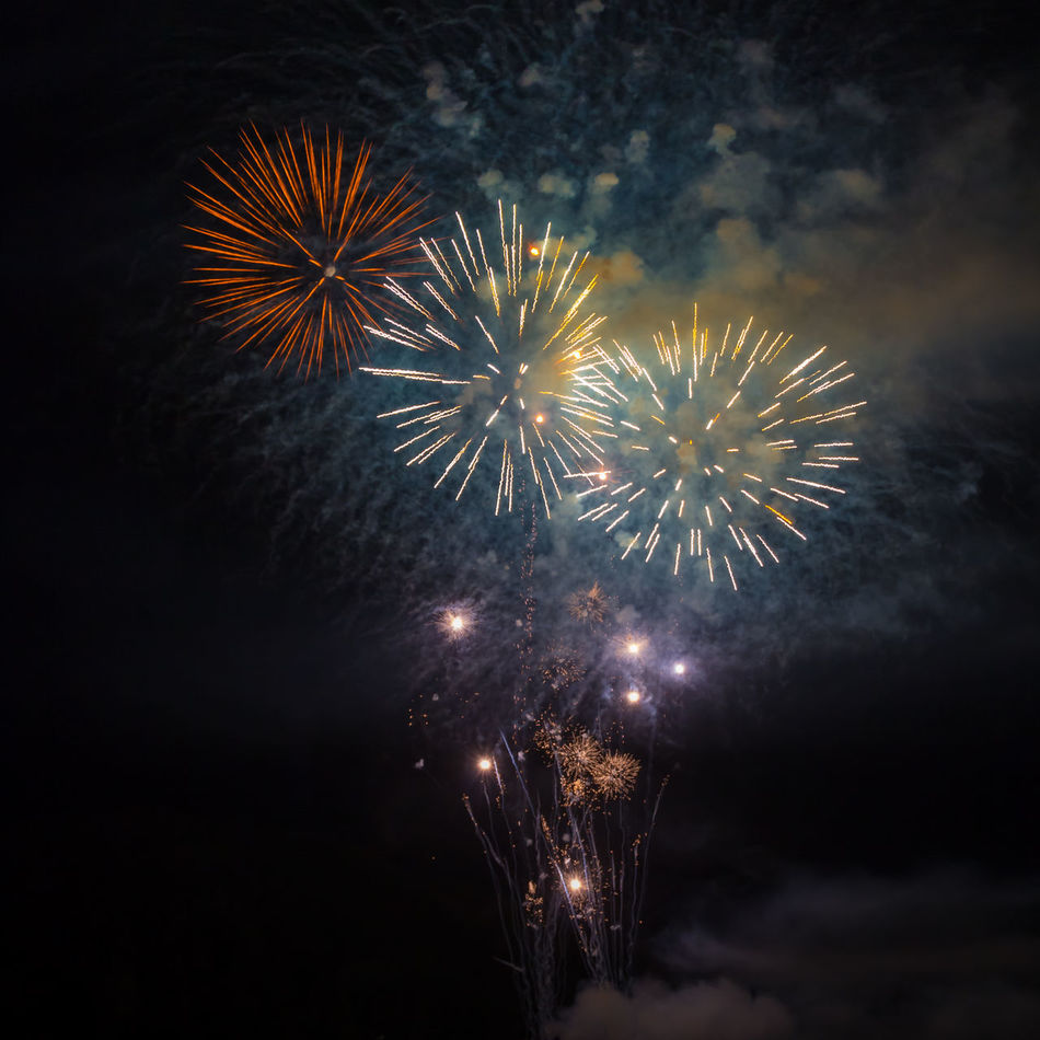 Celebration Event Exploding Firework Display Fireworks Illuminated Long Exposure Low Angle View Multi Colored Night Night Lights Night Photography No People Outdoors Pyrotechnics Sky Sparks