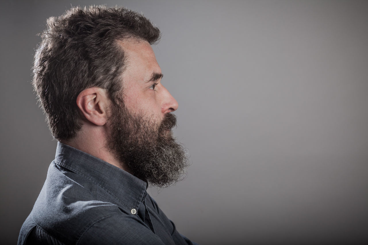 Mature man with long beard, head shots on grey background Adult Adults Only Beard Beautiful People Brown Hair Casual Clothing Confidence  Curly Hair Emotions Gray Background Grey Background Handsome Headshot Human Face Men One Man Only One Person Only Men People Portrait Profile Real People Series Side View Studio Shot