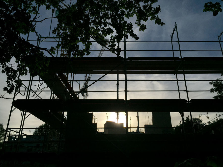 scaffolding in the evening sky Building Lot Building Site Construction Area Construction Site Eve Evening Evening Glow Evening Light Evening Sky Evening Sun Falsework Lot No People Scaffold Scaffolding Silhouette Sky Tree