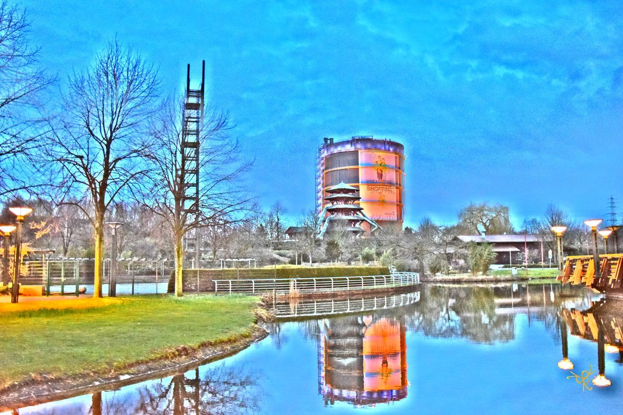 Architecture Blue Building Exterior Built Structure Centro Oberhausen City Gasometer Oberhausen Grass Industry Lake No People Oberhausen Outdoors Reflection River Sky Standing Water Tower Tree Water Waterfront