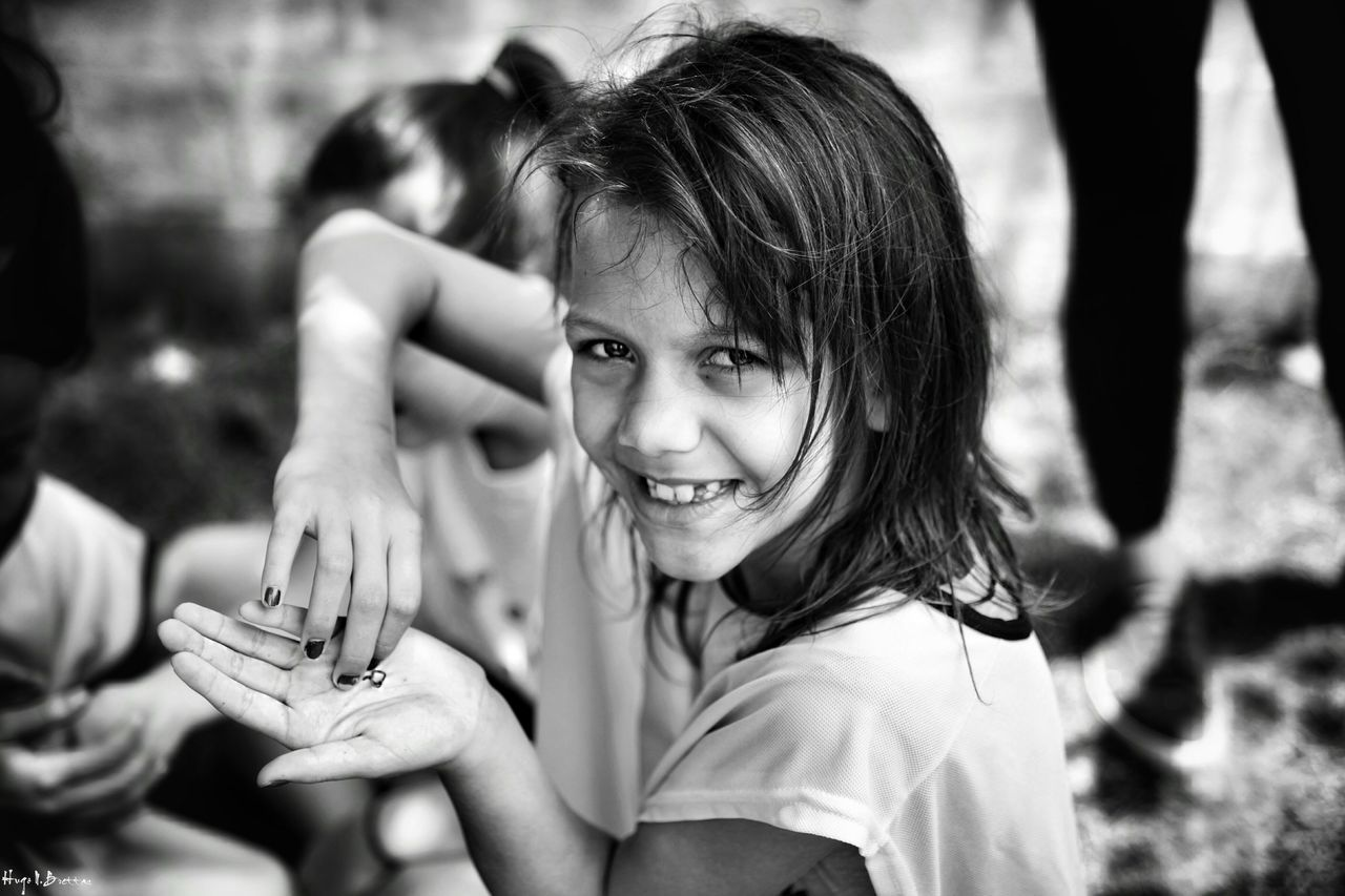 Portrait Smiling Girls One Person Leisure Activity Outdoors Cheerful People Women Close-up Young Women Happiness Freshness Children Photography Social Documentary Black And White School Life  Social Photography Black & White Relaxation Children Day School Life  The Portraitist - 2017 EyeEm Awards