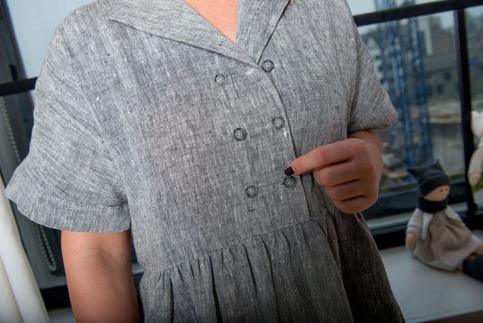 gray linen dress in close-up Business Business Finance And Industry Casual Clothing Close-up Clothes Line Dress Fashion Front View Gray Indoors  Linen Linen Texture Linens Midsection Model People Real People Small Business Standing Summer Fashion Fashion Details