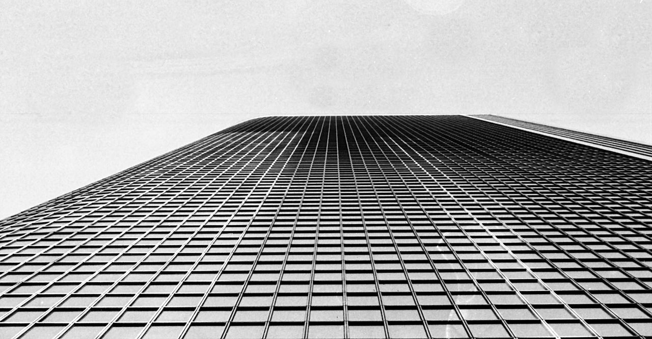 Architecture Modern Built Structure Skyscraper Building Exterior Low Angle View Repetition No People Sky Tall Day Outdoors City Canon Film Camera 35mmfilmphotography Film Photography Filmisnotdead Filmcamera Film Noir