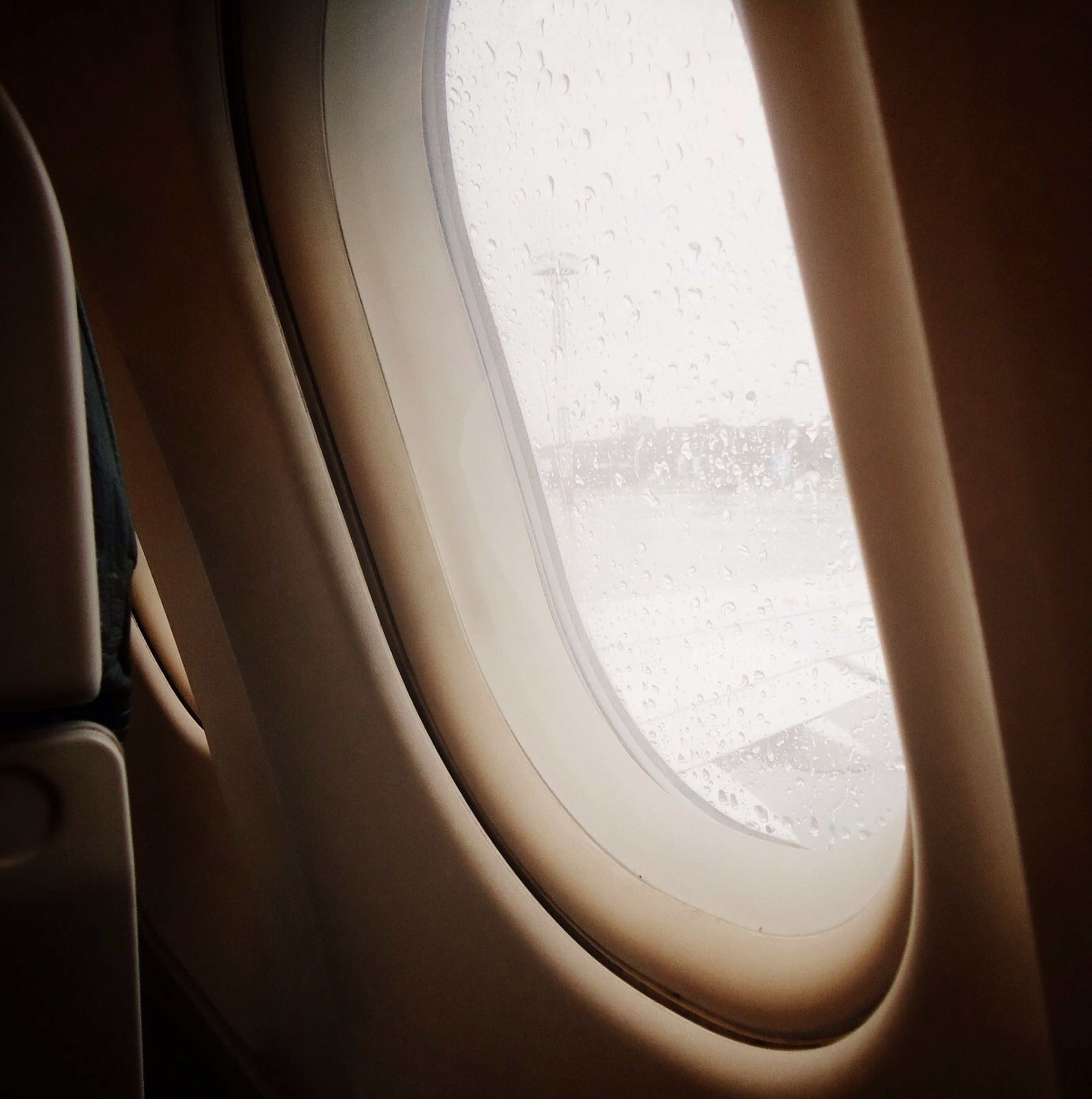 indoors, close-up, transportation, window, mode of transport, part of, full frame, high angle view, vehicle interior, white color, glass - material, no people, airplane, backgrounds, transparent, car, detail, cropped, reflection, white