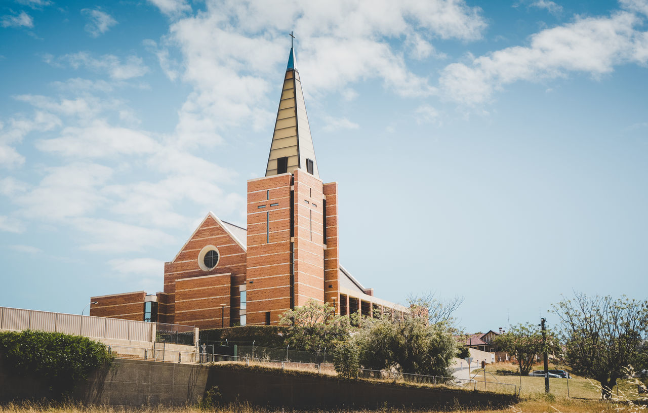 Newly built in 2005 after a tornado demolished the original one St Patrick's Catholic Cathedral stands on the hill in Bunbury Western Australia on a cloudy afternoon in late autumn. Architecture Building Exterior Built Structure Day No People Outdoors Place Of Worship Sky Tower Tree