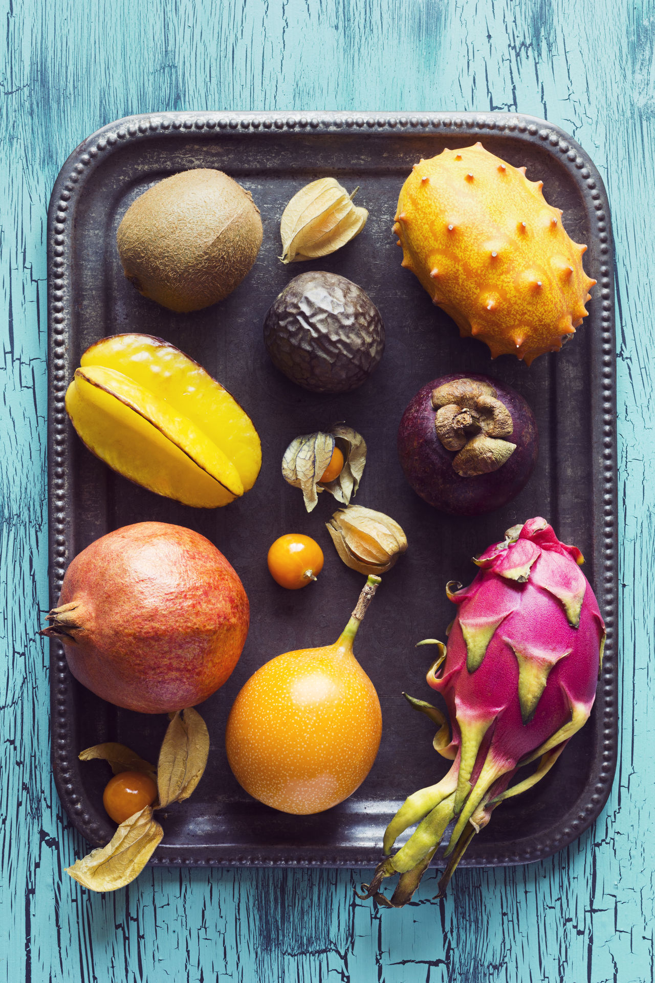 Blue Cape Gooseberry Carambola Dragonfruit Flat Lay Food Fruit Fruits Granadilla Ingredients Kiwi Mangosteen Melano No People Passion Fruit Passionfruit Physalis Pitaya Pomegranate Star Fruit  Table Top Down Tray Tropical Fruit Visual Feast