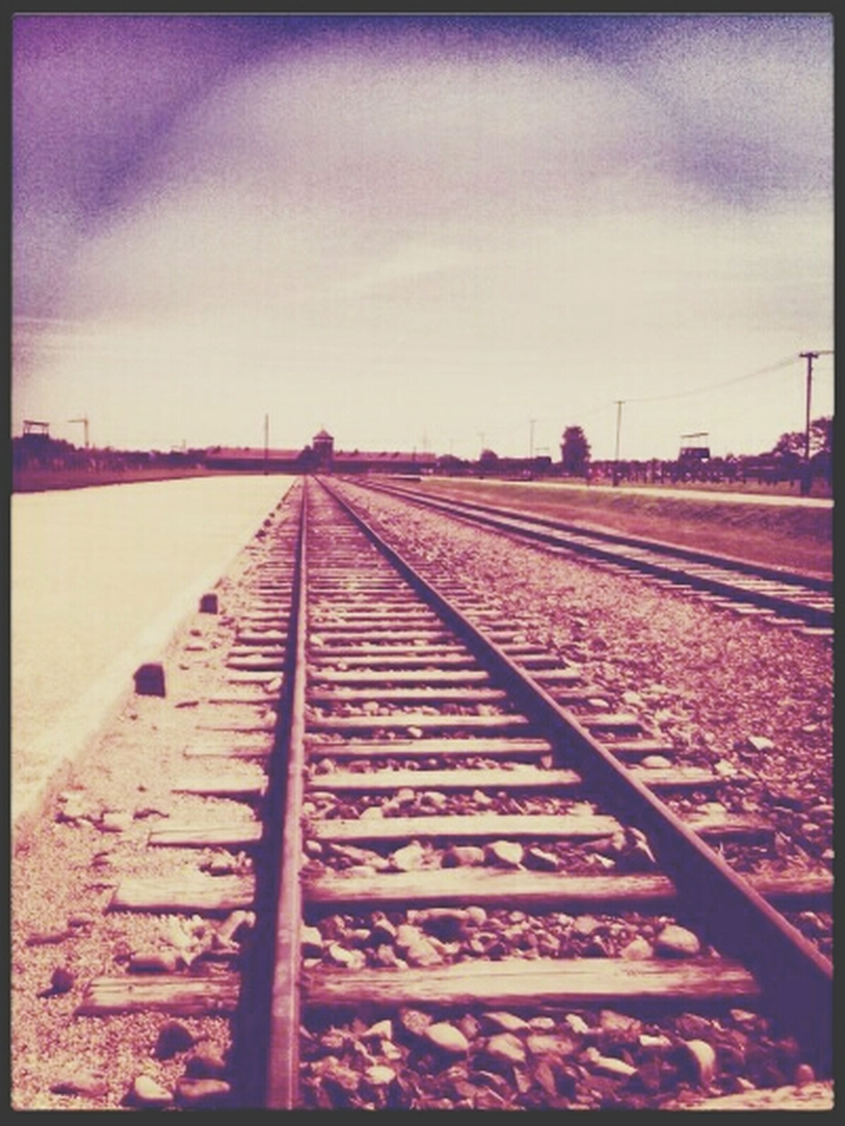 railroad track, sky, transfer print, the way forward, auto post production filter, rail transportation, diminishing perspective, transportation, vanishing point, cloud - sky, surface level, outdoors, cloud, day, cloudy, metal, no people, railway track, long, landscape