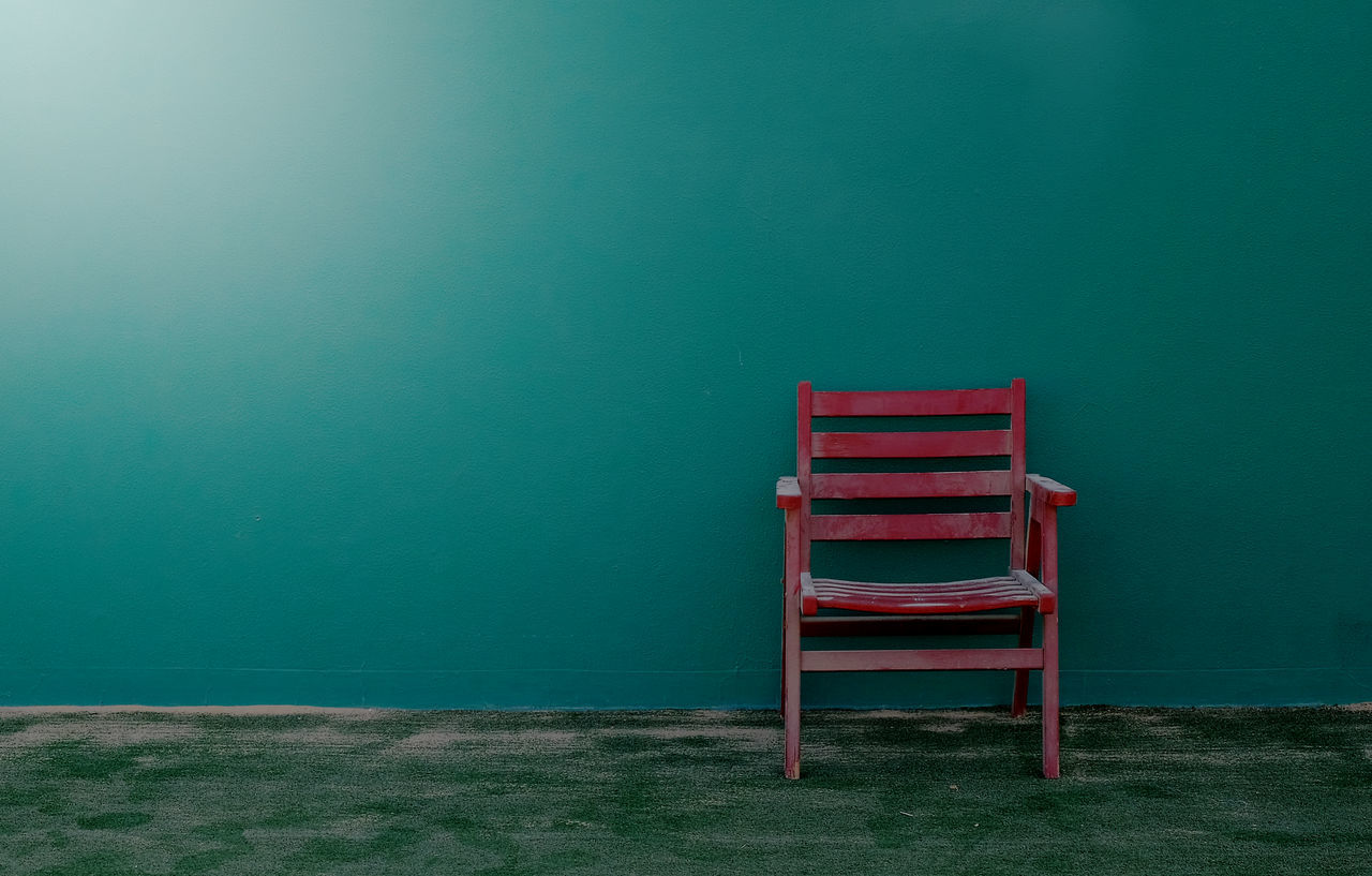 Abandoned Chair Day Dirt Dust Green Wall Neglected No People Red Chair Sand Simplicity Tennis Court Tranquil Scene Outdoors Tranquility