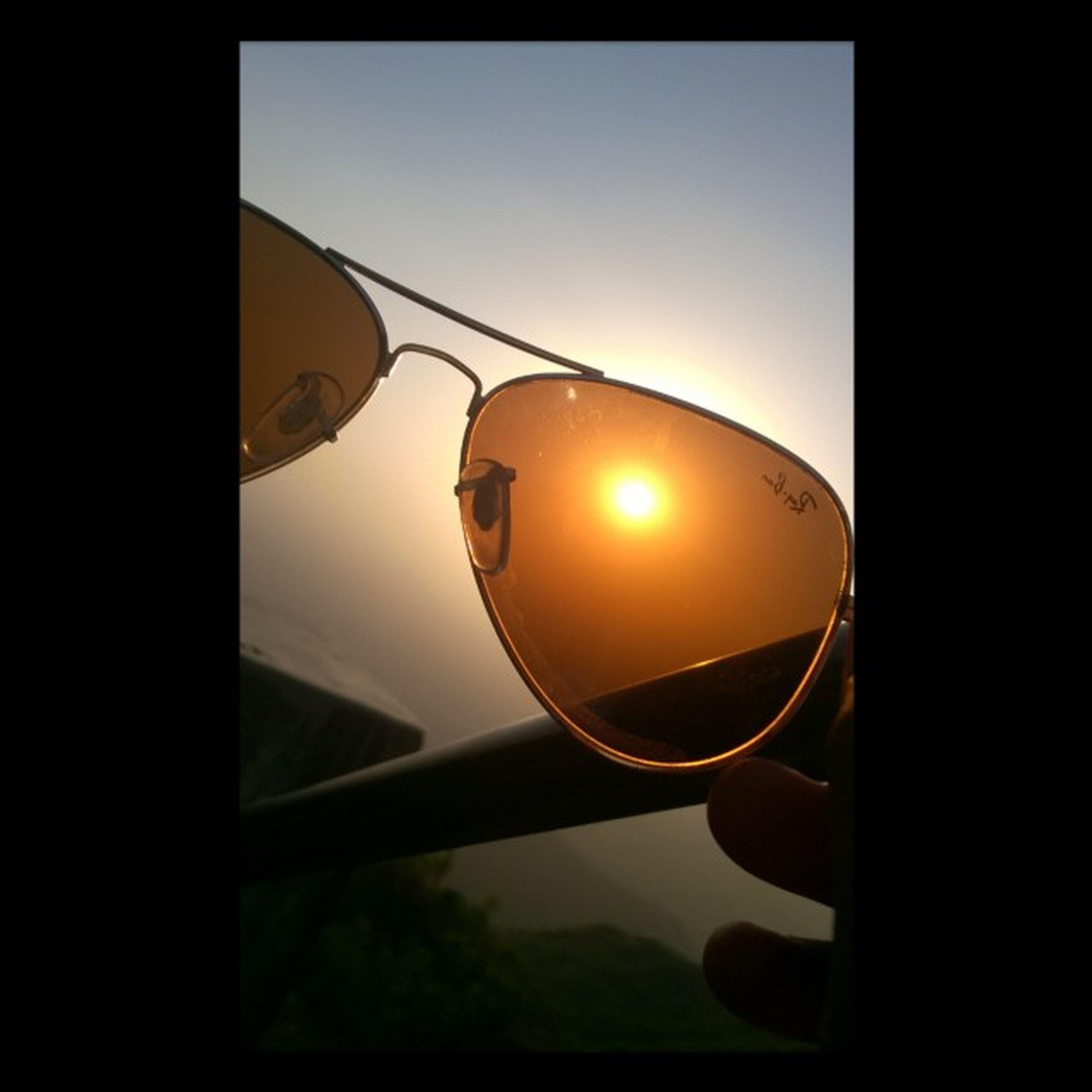 sunset, sun, silhouette, sky, glass - material, transparent, orange color, window, transportation, clear sky, reflection, close-up, lighting equipment, sunlight, nature, no people, transfer print, dark, indoors, street light