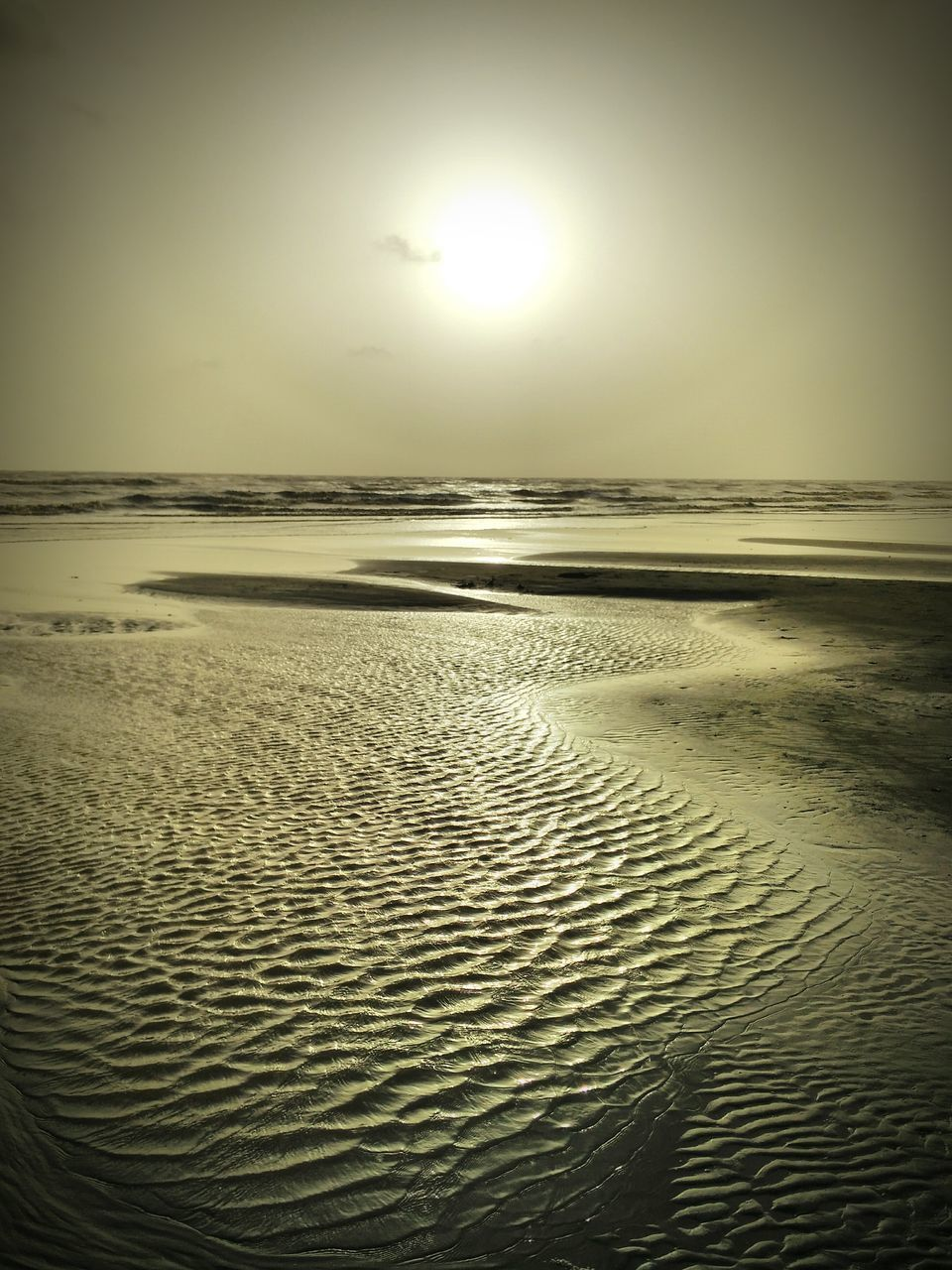 sea, water, sun, nature, beauty in nature, beach, tranquility, scenics, sand, tranquil scene, sunset, reflection, sky, idyllic, outdoors, no people, waterfront, sunlight, horizon over water, clear sky, landscape, day