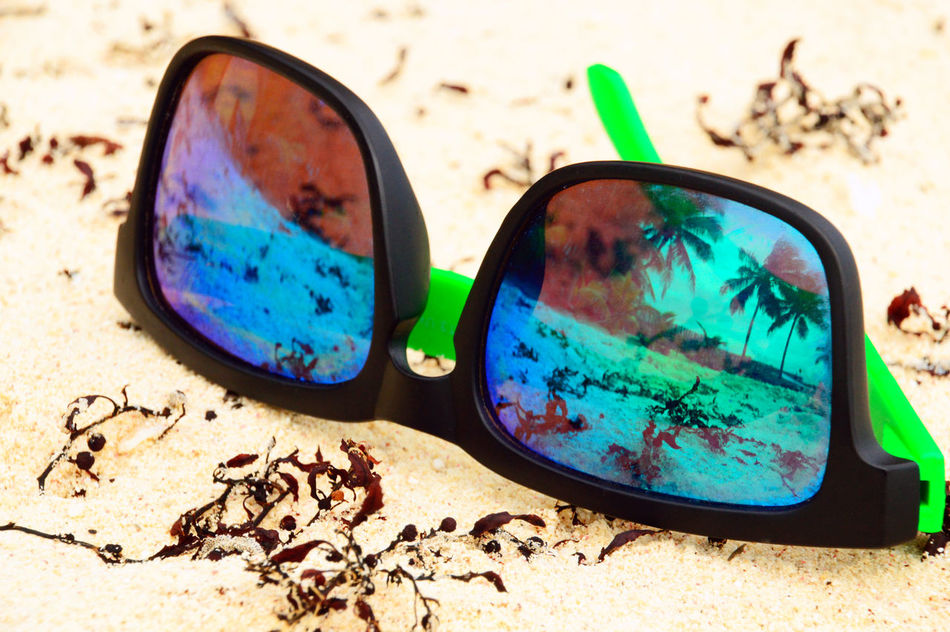 Abandoned Beach Blue Car Close-up Day Focus On Foreground Land Vehicle Mode Of Transport Nature No People Outdoors Part Of Reflection Sand Single Object Stationary Sunglasses Sunlight Transportation Palm Trees Palm Palm Reflect Sunglasses👓 Sunglasses Reflection