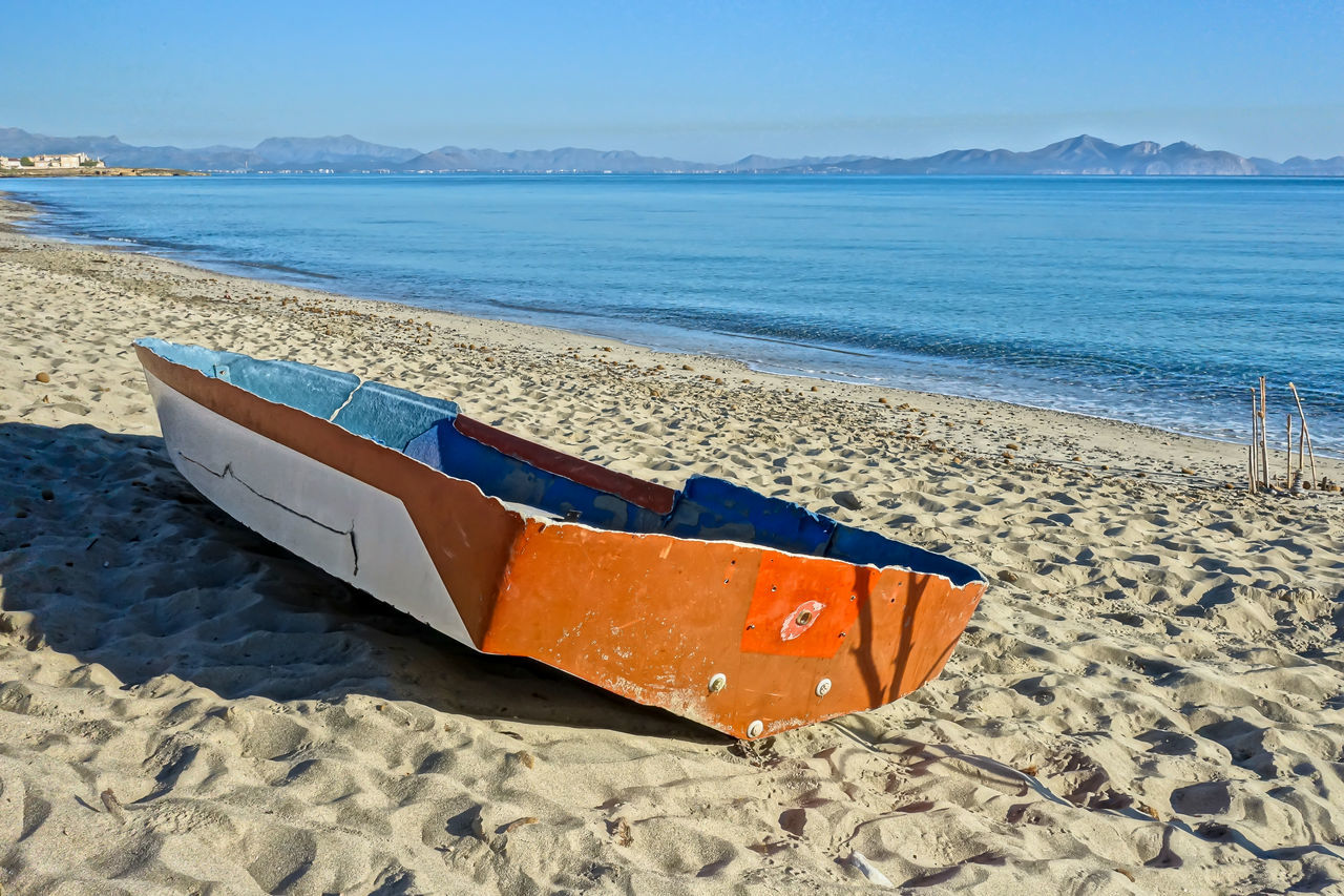 Beach Beauty In Nature Blue Boat Day Horizon Over Water Moored Nature Nautical Vessel No People Outdoors Sand Scenics Sea Shore Sky Son Serra De Marina Sunlight Tranquil Scene Tranquility Transportation Water