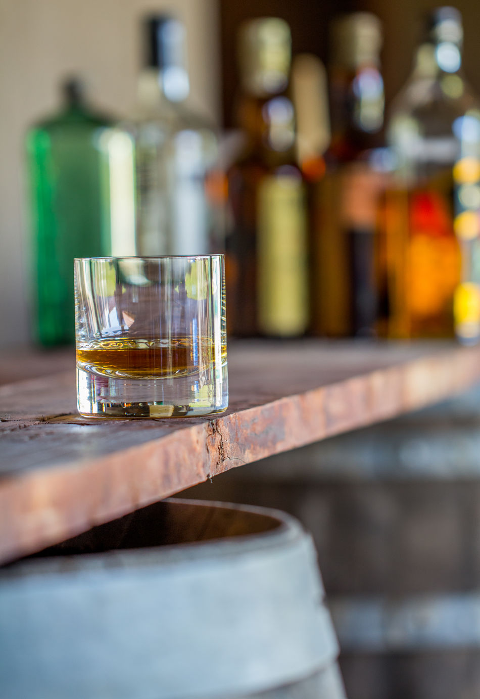 Food And Drink Drinking Glass Food And Drink Industry Drink Close-up No People Alcohol Indoors  Whiskey Bottles Bar Table Wood Barrels Status GLAMOR Golden