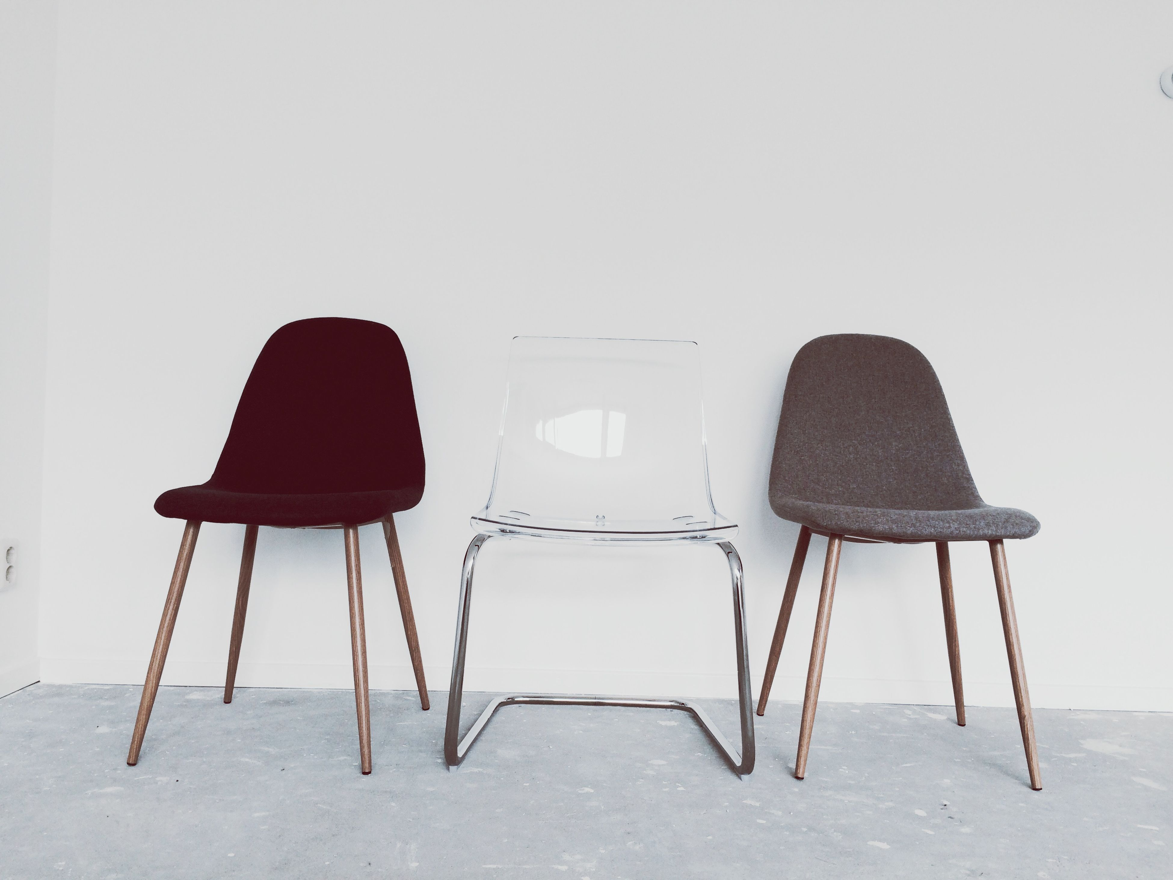 chair, absence, empty, table, indoors, seat, furniture, still life, wall - building feature, wood - material, wall, no people, shadow, arrangement, copy space, day, home interior, flooring, sand, relaxation